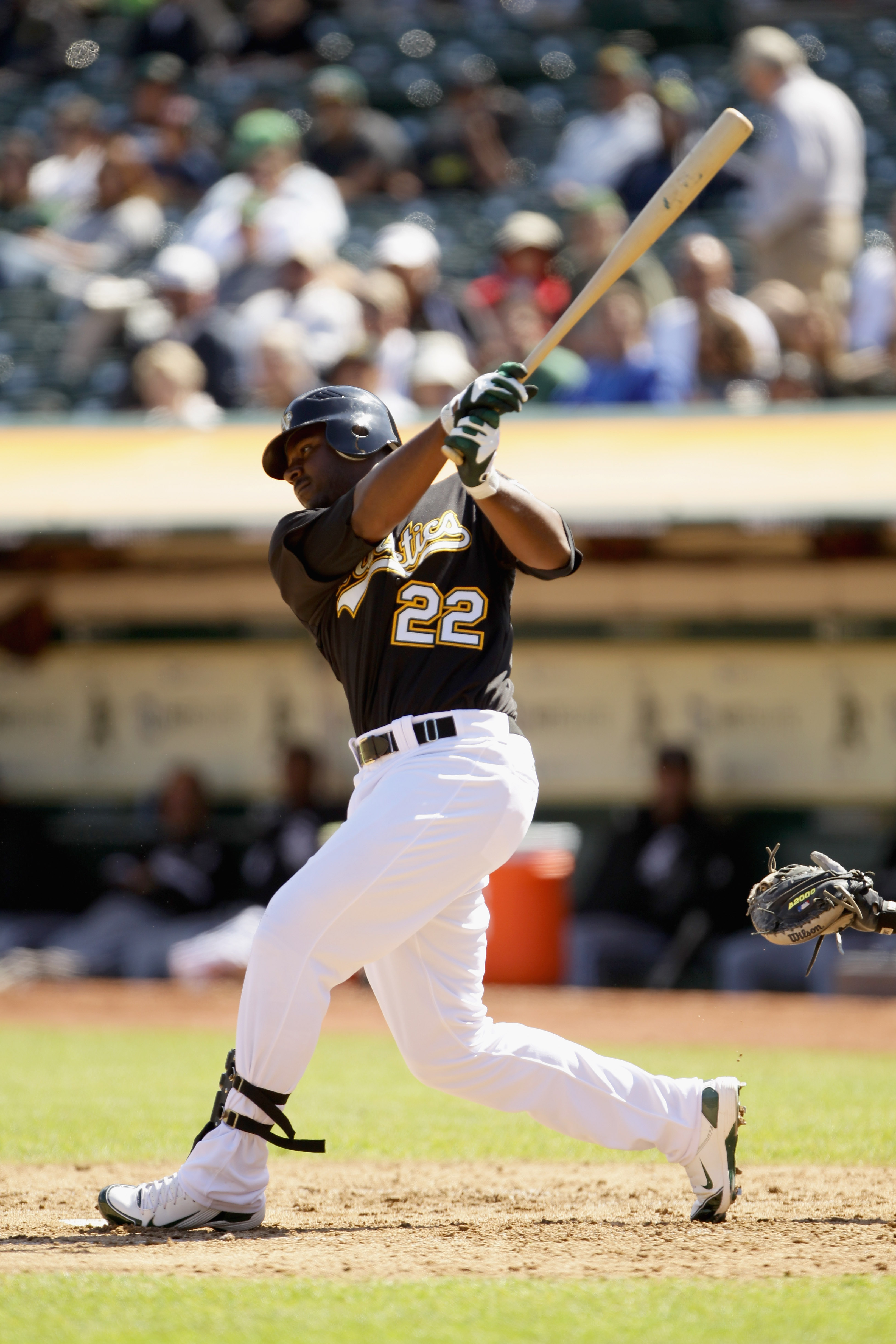 OAKLAND, CA - SEPTEMBER 22:  Chris Carter #22 of the Oakland Athletics bats against the Chicago White Sox at the Oakland-Alameda County Coliseum on September 22, 2010 in Oakland, California.  (Photo by Ezra Shaw/Getty Images)