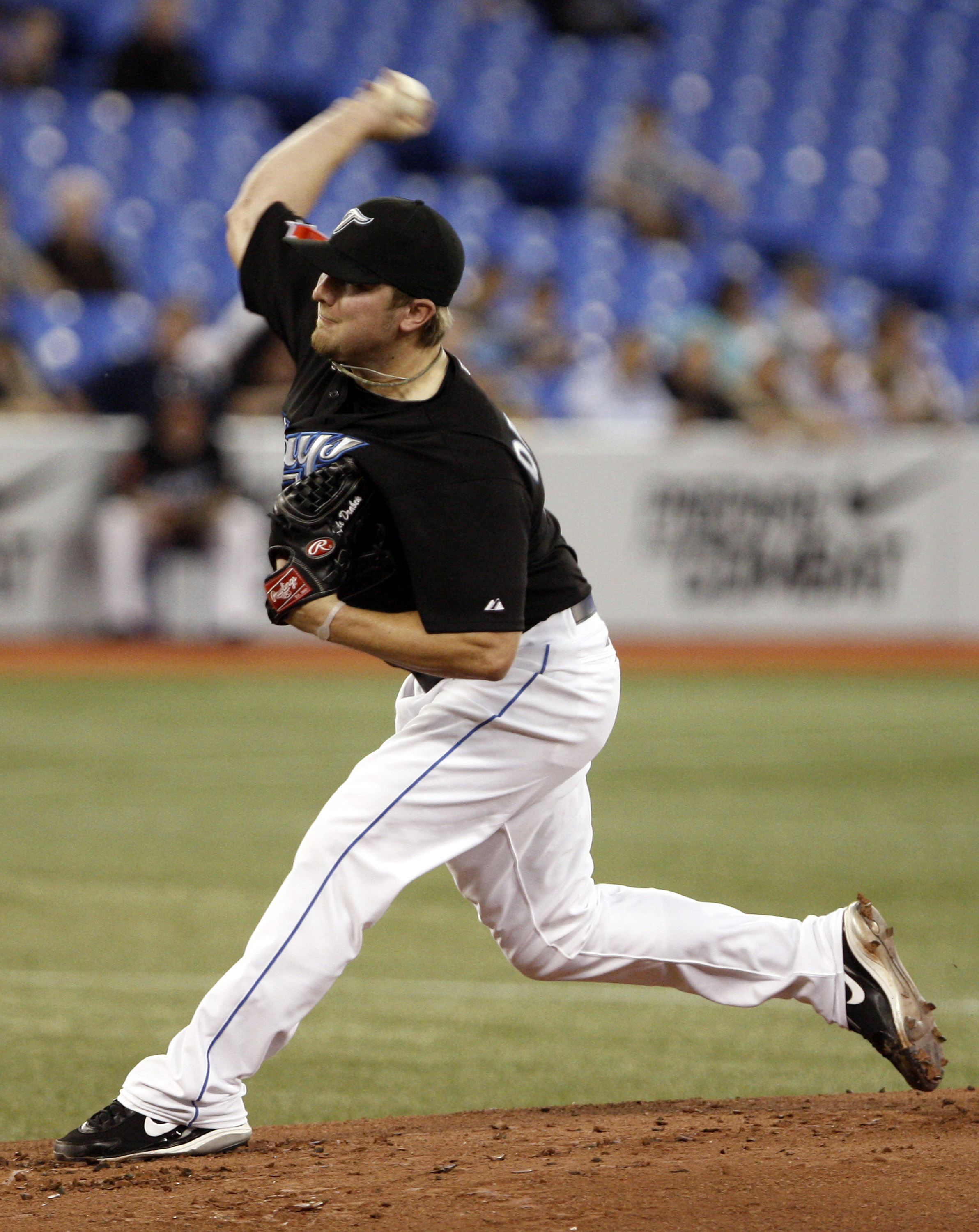 TORONTO, ON - SEPTEMBER 28: Kyle Drabek #4 of the Toronto Blue Jays throws agianst the New York Yankees during an MLB game at the Rogers Centre September 28, 2010 in Toronto, Ontario, Canada. (Photo by Abelimages/Getty Images)
