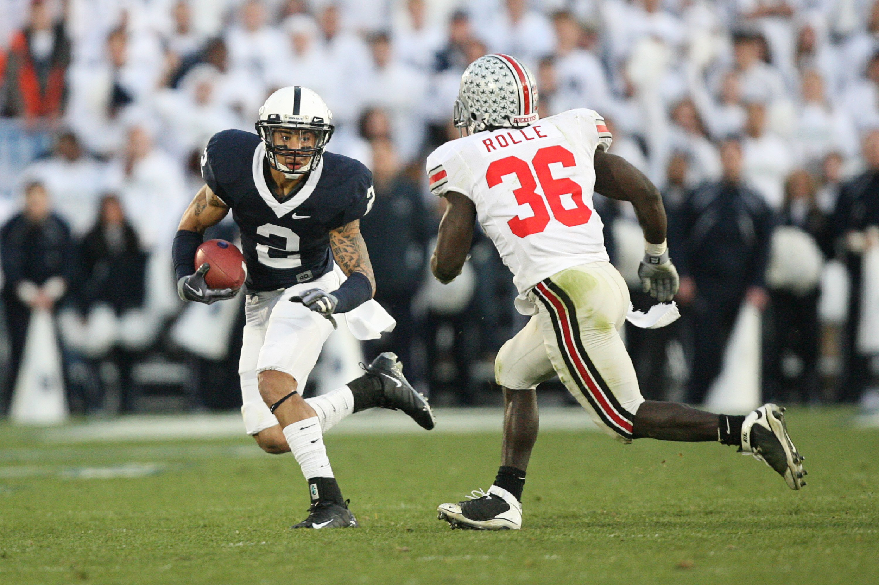 STATE COLLEGE, PA - NOVEMBER 7: Wide receiver Chaz Powell #2 of the Penn State Nittany Lions runs with the ball as linebacker Brian Rolle #36 of the Ohio State Buckeyes pursues during a game on November 7, 2009 at Beaver Stadium in State College, Pennsylv