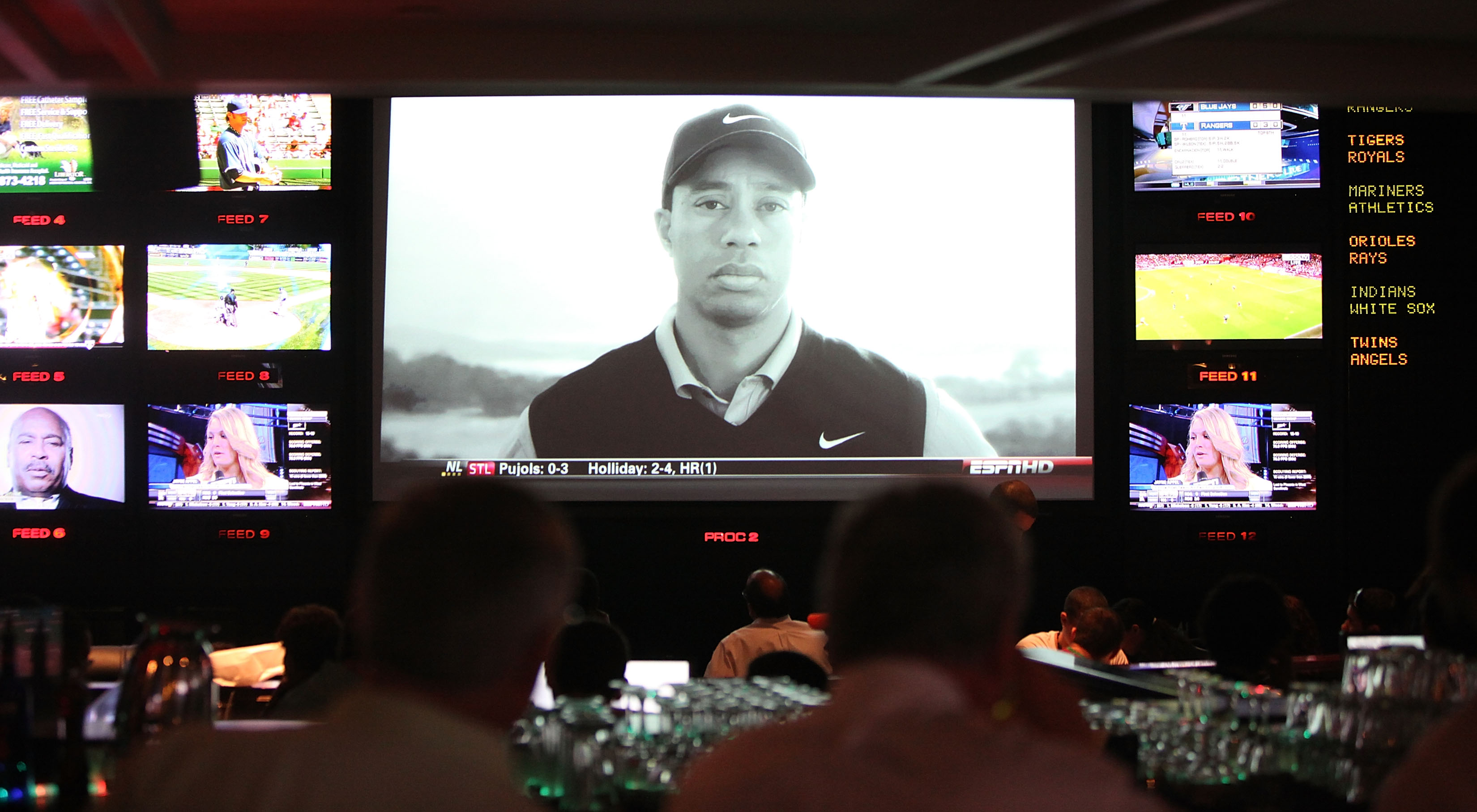 NEW YORK - APRIL 08:  Sports fans watch the controversial new Tiger Woods Nike advertisement featuring the voice of his late father Earl during Masters coverage televised at ESPN Zone April 8, 2010 in New York City. Woods is playing in the Masters for his