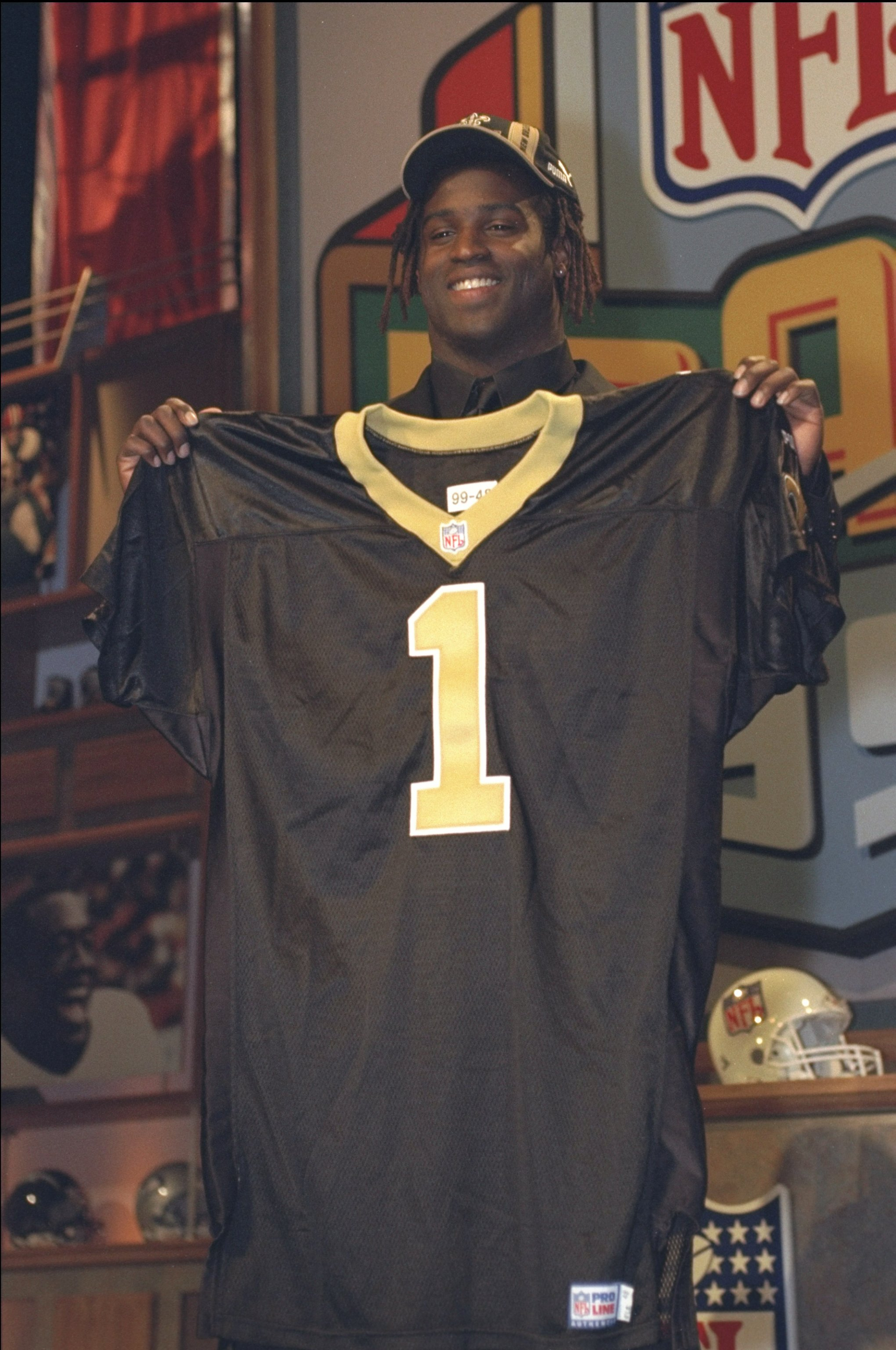 17 Apr 1999: The fifth draft pick Ricky Williams holds his new New Orleans Saints jersey during the NFL Draft at the Madison Square Garden in New York, New York.
