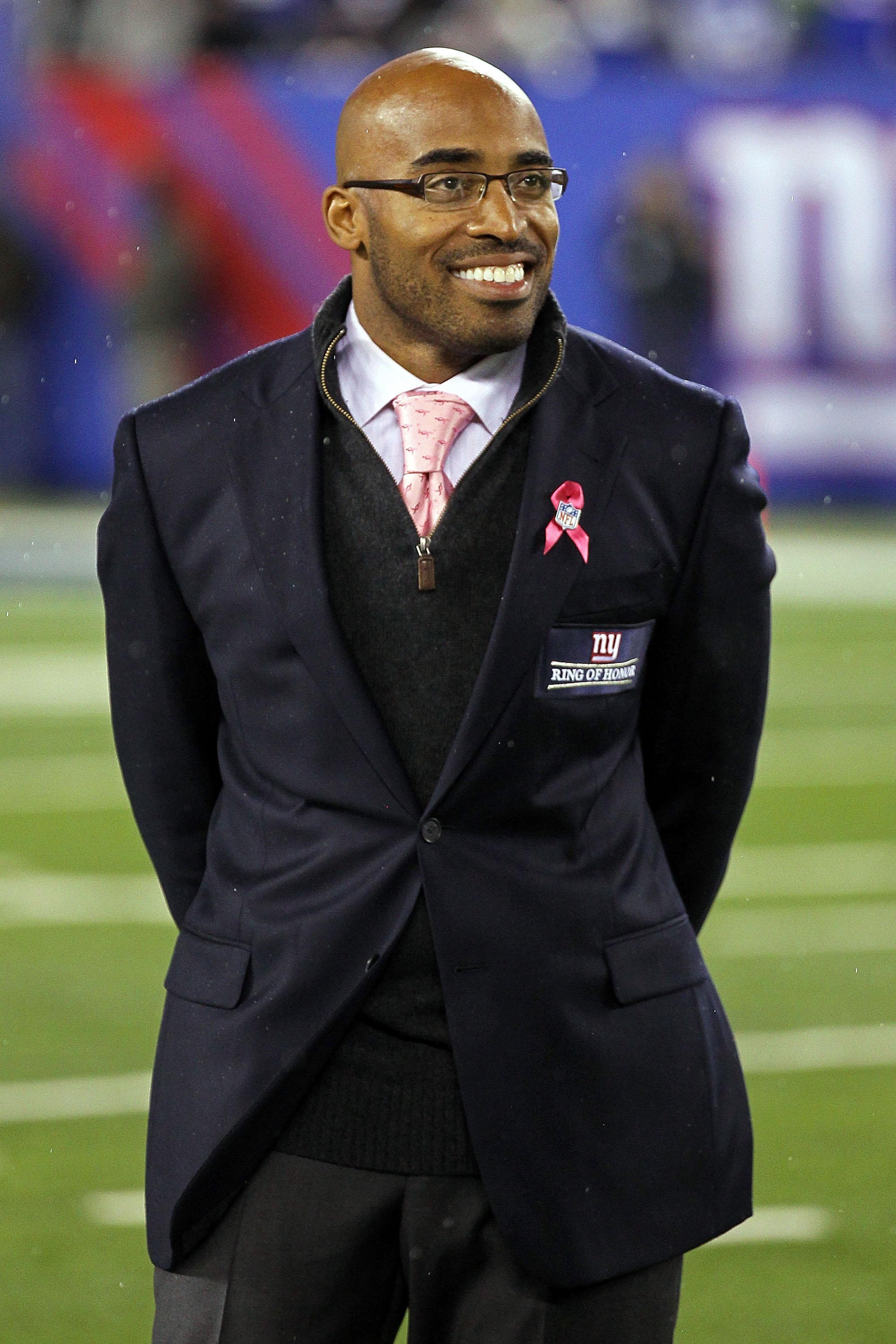 EAST RUTHERFORD, NJ - OCTOBER 03:  Former New York Giants Tiki Barber is inducted into the Giants �Ring of Honor� during halftime of a game between the Chicago Bears and the New York Giants at New Meadowlands Stadium on October 3, 2010 in East Rutherford,