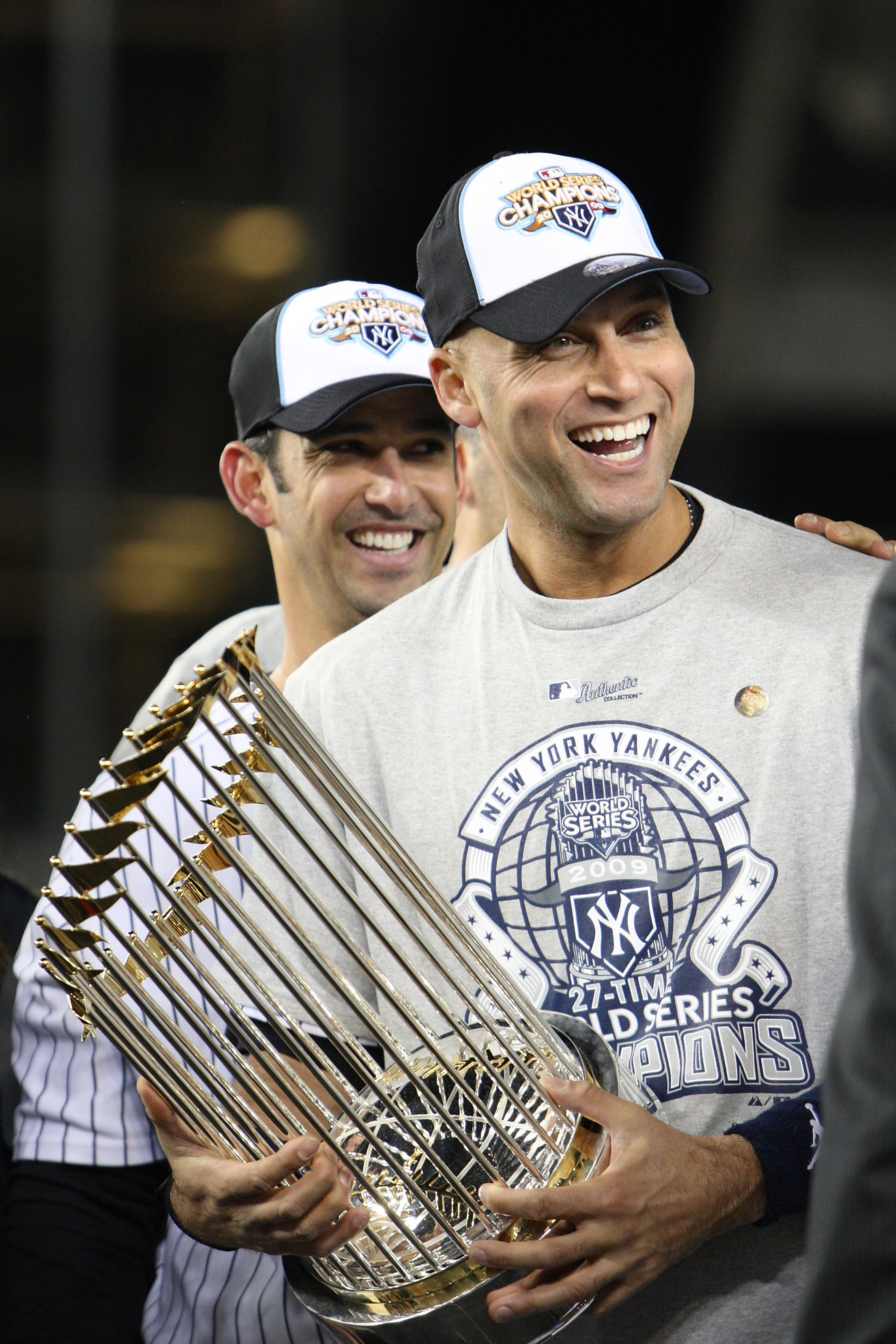 NEW YORK - NOVEMBER 04:  Derek Jeter #2 of the New York Yankees celebrates with the trophy after their 7-3 win against the Philadelphia Phillies in Game Six of the 2009 MLB World Series at Yankee Stadium on November 4, 2009 in the Bronx borough of New Yor