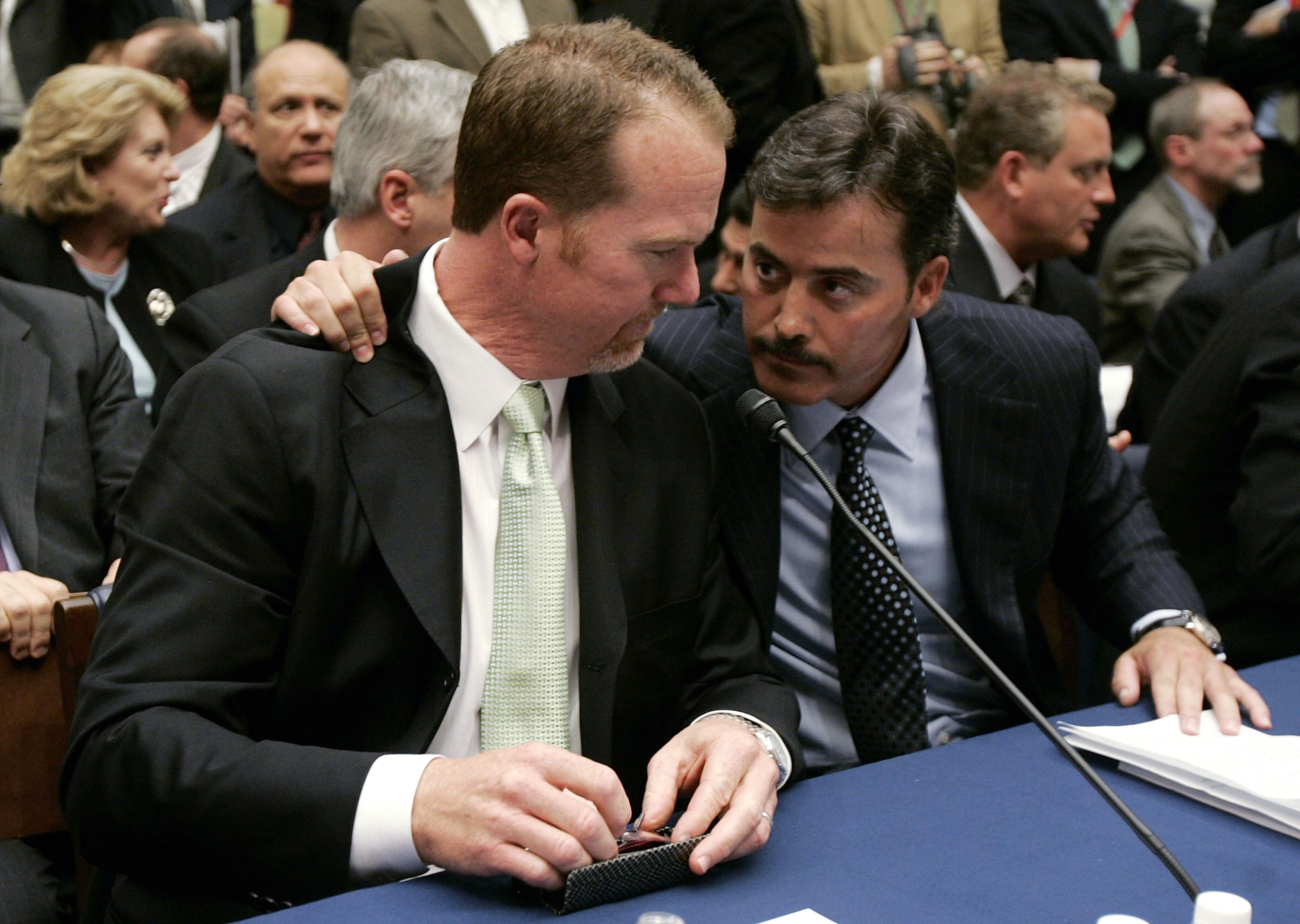 WASHINGTON - MARCH 17:  Former St. Louis Cardinal Mark McGwire (L) talks with Rafael Palmeiro of the Baltimore Orioles during a House Committe session investigating Major League Baseball's effort to eradicate steroid use on Capital Hill March 17, 2005 in