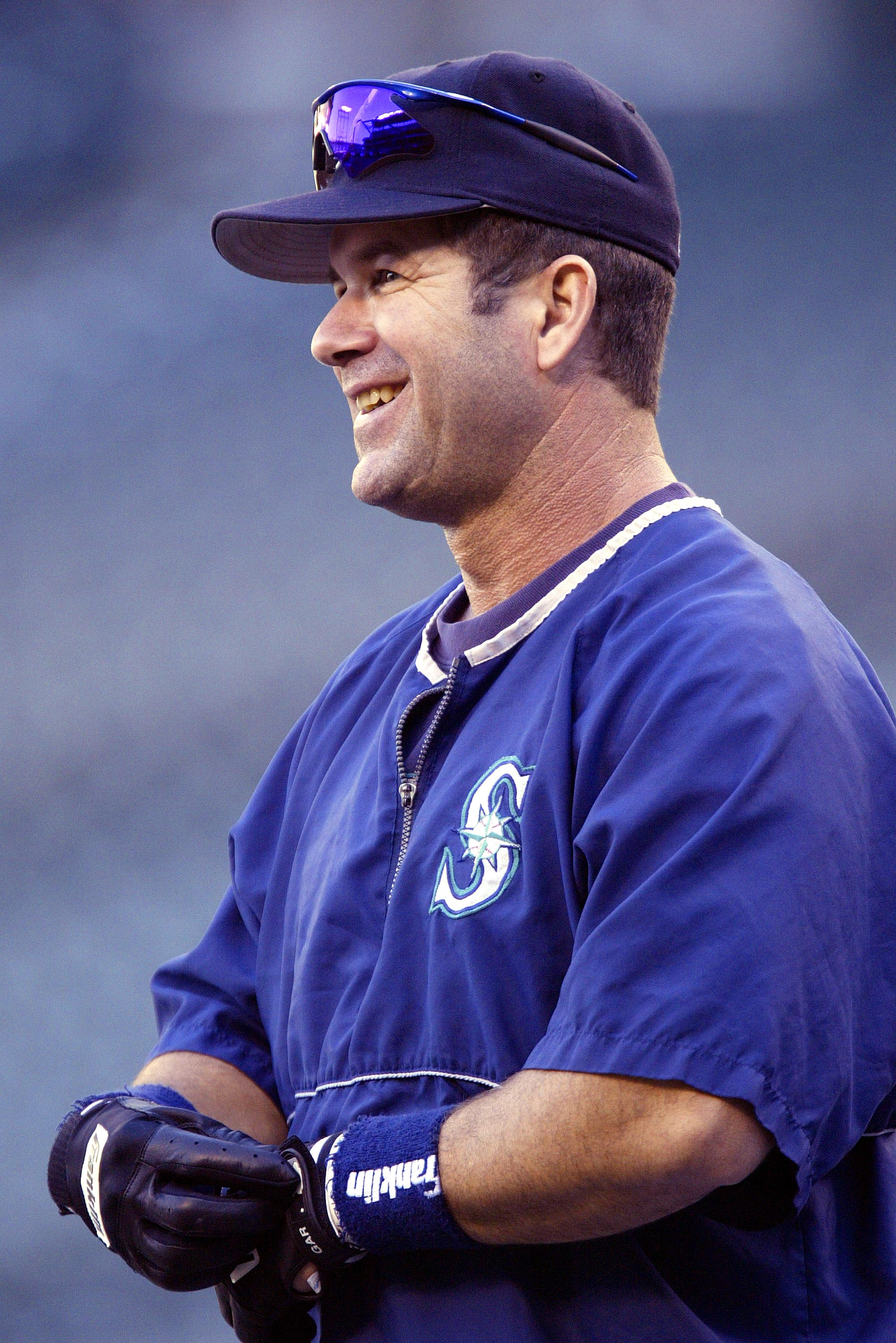 SEATTLE - OCTOBER 1:  Designated hitter Edgar Martinez #11 of the Seattle Mariners smiles during practice for the game against the Texas Rangers on October 1 2004 at Safeco Field in Seattle, Washington. Edgar Martinez plans to retire at the end of the sea