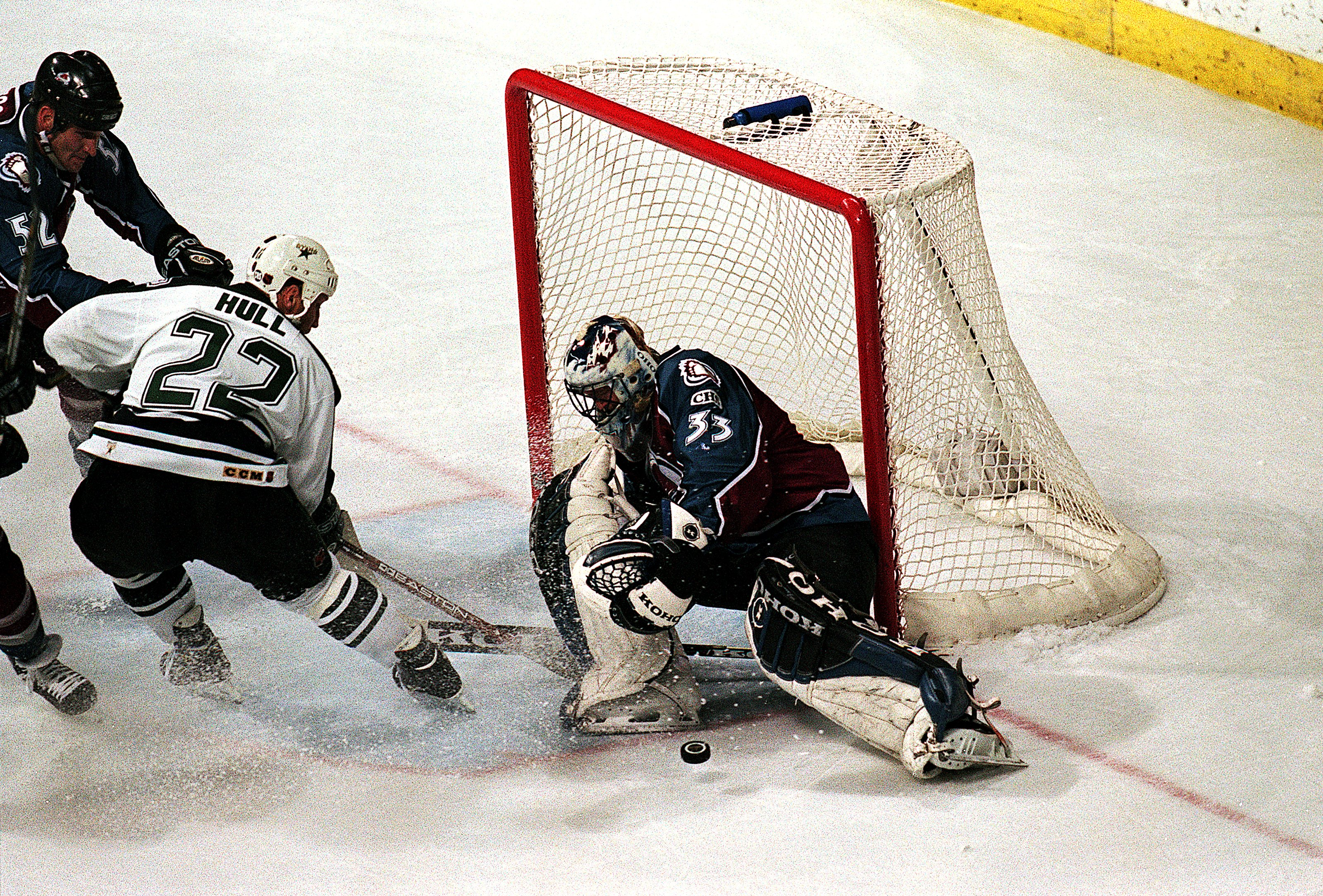 24 May 1999: Patrick Roy #33 of the Colorado Avalanche blocks the puck as Brett Hull #22 of the Dallas Stars tries to score during the Western Conference Finals at the Reunion Arena in Dallas, Texas. The Stars defeated the Avalanche 4-2. Mandatory Credit: