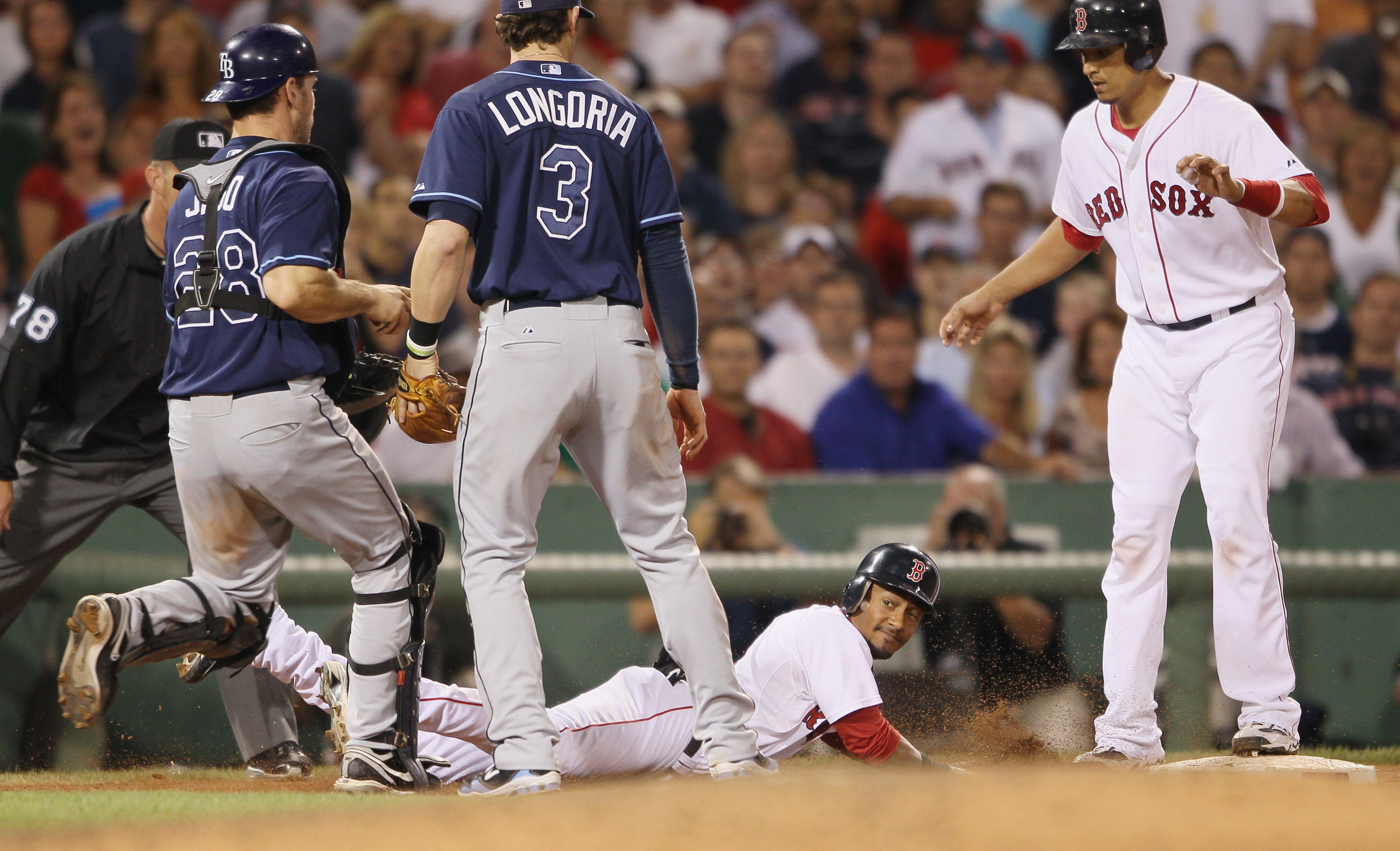 BOSTON - SEPTEMBER 08:  Eric Patterson #3 of the Boston Red Sox slides safely back to third as Evan Longoria #3 and John Jaso #28 of the Tampa Bay Rays chase him on September 8, 2010 at Fenway Park in Boston, Massachusetts. Patterson thought he was called