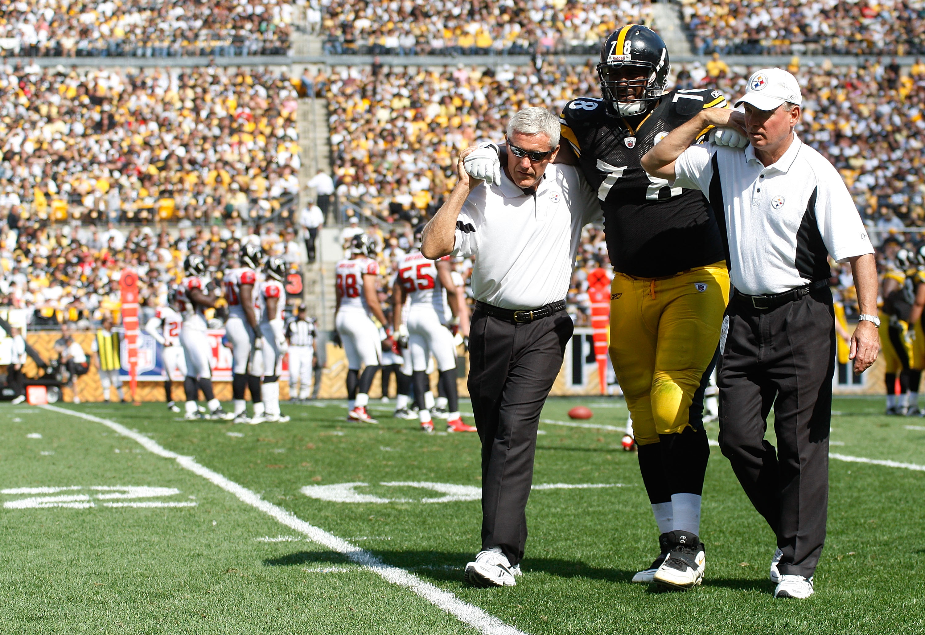 PITTSBURGH - SEPTEMBER 12:  Max Starks #78 of the Pittsburgh Steelers is helped off of the field after getting injured against the Atlanta Falcons during the NFL season opener game on September 12, 2010 at Heinz Field in Pittsburgh, Pennsylvania.  (Photo