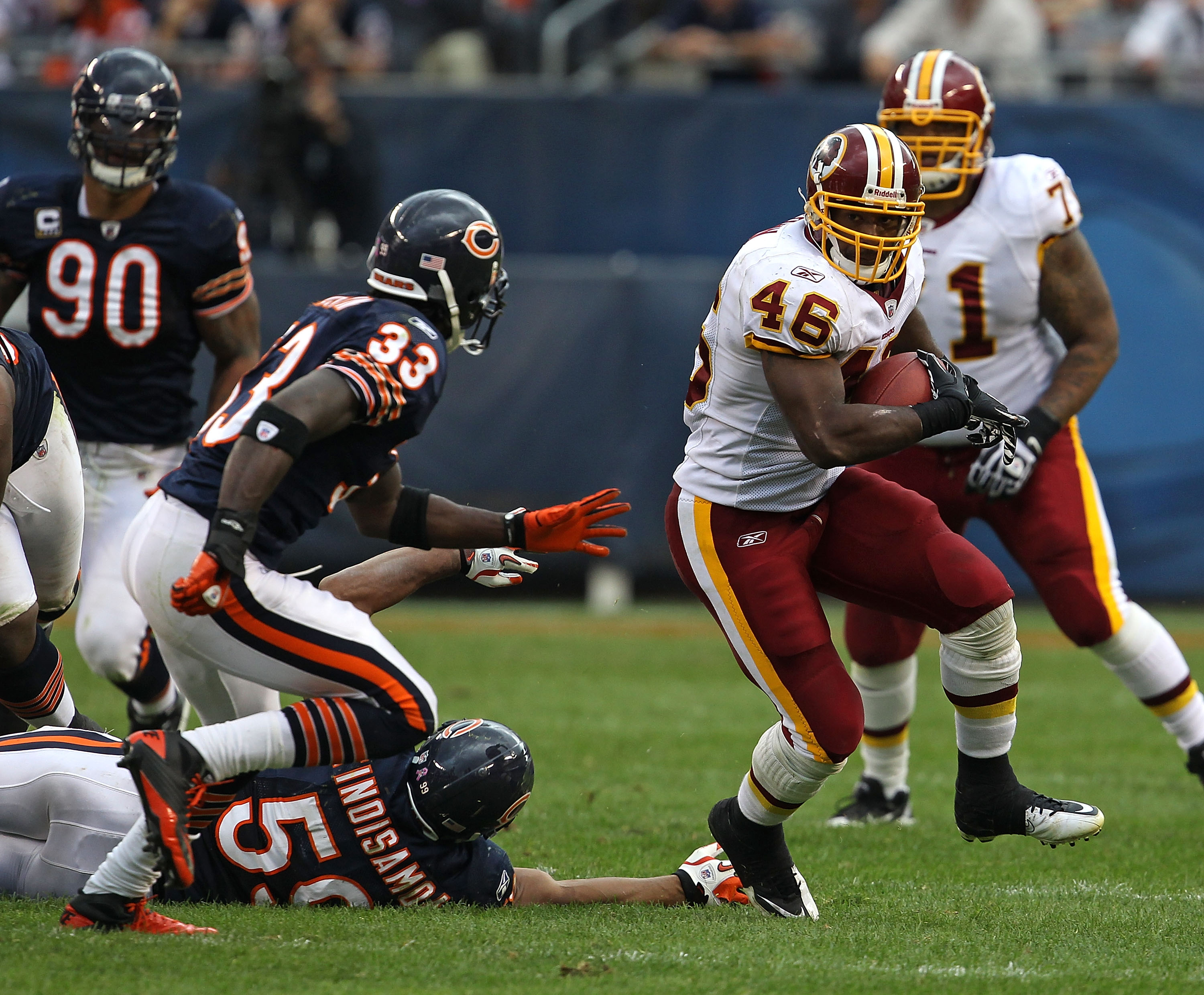 CHICAGO - OCTOBER 24: Ryan Torain #46 of the Washington Redskins runs past Pisa Tinoisamoa #59 of the Chicago Bears as Charles Tillman #33 closes in at Soldier Field on October 24, 2010 in Chicago, Illinois. The Redskins defeated the Bears 17-14. (Photo b