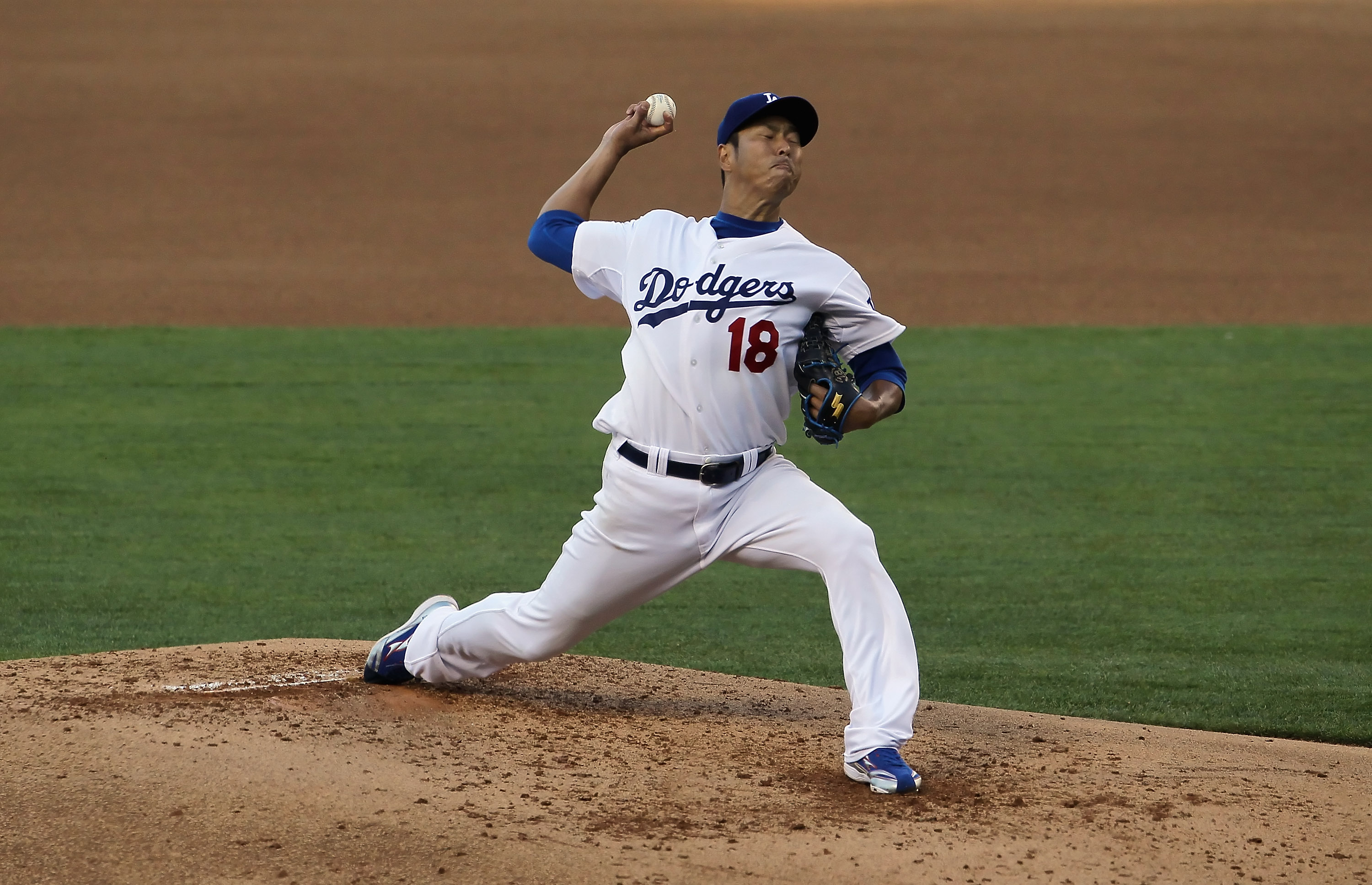 LOS ANGELES, CA - SEPTEMBER 05:  Hiroki Kuroda #18 of the Los Angeles Dodgers pitches in the third inning against the San Francisco Giants at Dodger Stadium on September 5, 2010 in Los Angeles, California. The Giants defeated the Dodgers 3-0.  (Photo by J