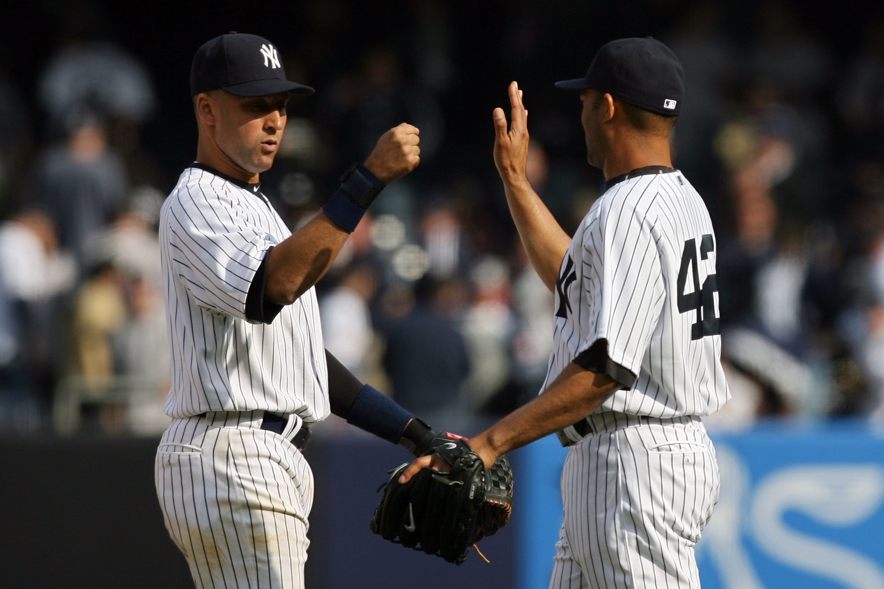 NEW YORK - APRIL 13:  Derek Jeter #2 and Mariano Rivera #42 of the New York Yankees celebrate after defeating the Los Angeles Angels of Anaheim during the Yankees home opener at Yankee Stadium on April 13, 2010 in the Bronx borough of New York City.  (Pho