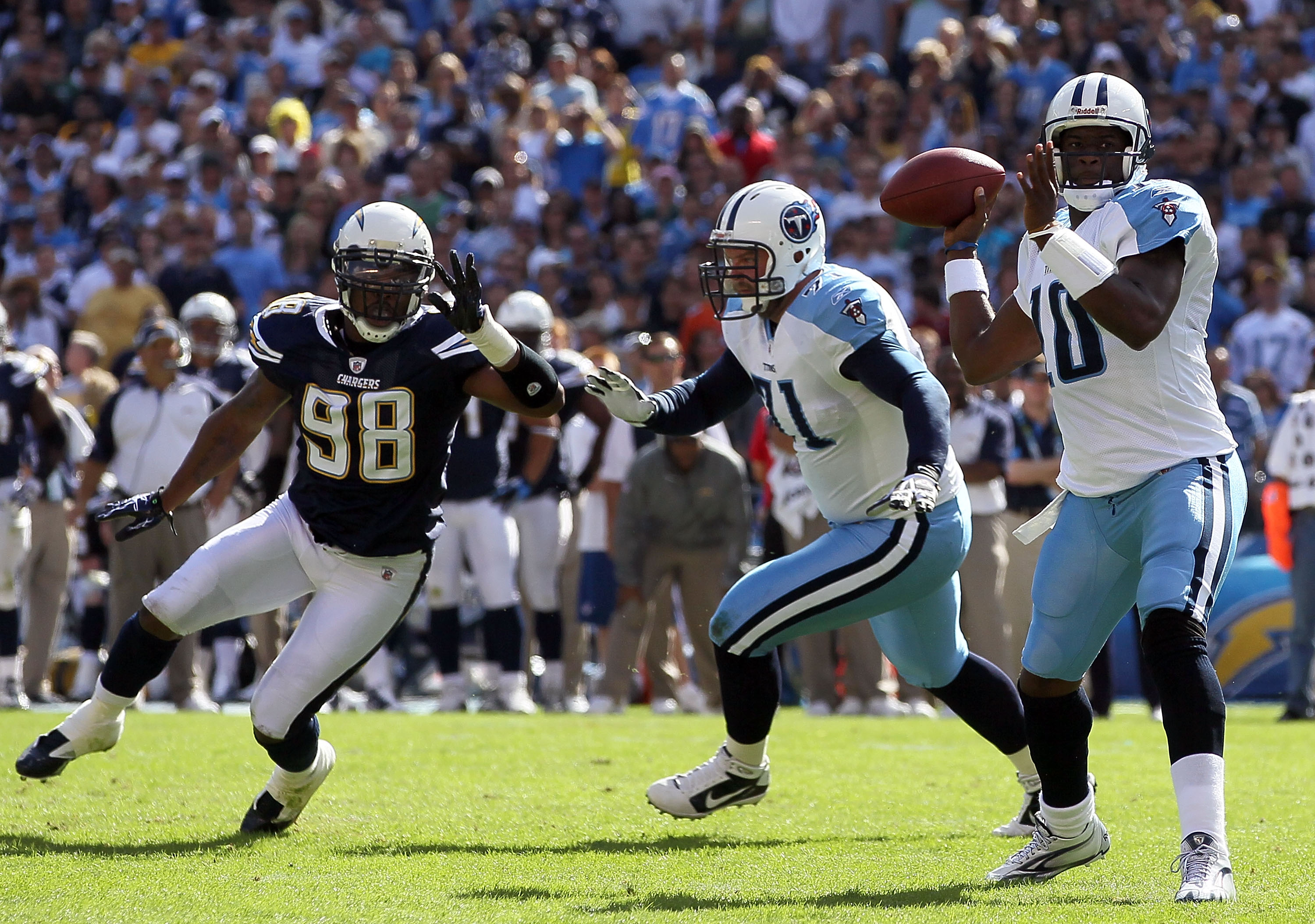 SAN DIEGO - OCTOBER 31:  Quarterback Vince Young #10 of the Tennessee Titans drops back to pass as Antwan Barnes #98 of the San Diego Chargers pressures during the game at Qualcomm Stadium on October 31, 2010 in San Diego, California. The Chargers defeate