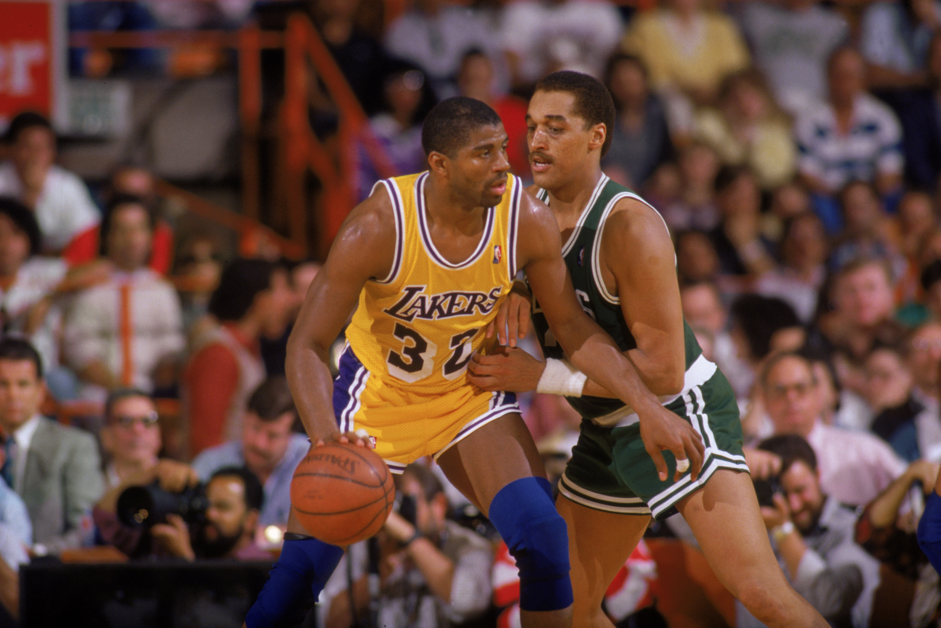 LOS ANGELES - 1987:  Magic Johnson #32 of the Los Angeles Lakers posts up Dennis Johnson #3 of the Boston Celtics during an NBA game at the Great Western Forum in Los Angeles, California in 1987. (Photo by: Rick Stewart/Getty Images)