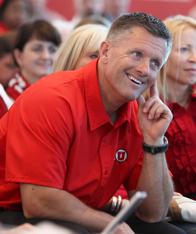 SALT LAKE CITY, UT - JUNE 17: University of Utah Head football coach Kyle Whittingham smiles as it is announced that the University will be admitted into the PAC-10 June 17, 2010 in Salt Lake City, Utah. The University of Utah was invited to join the PAC-