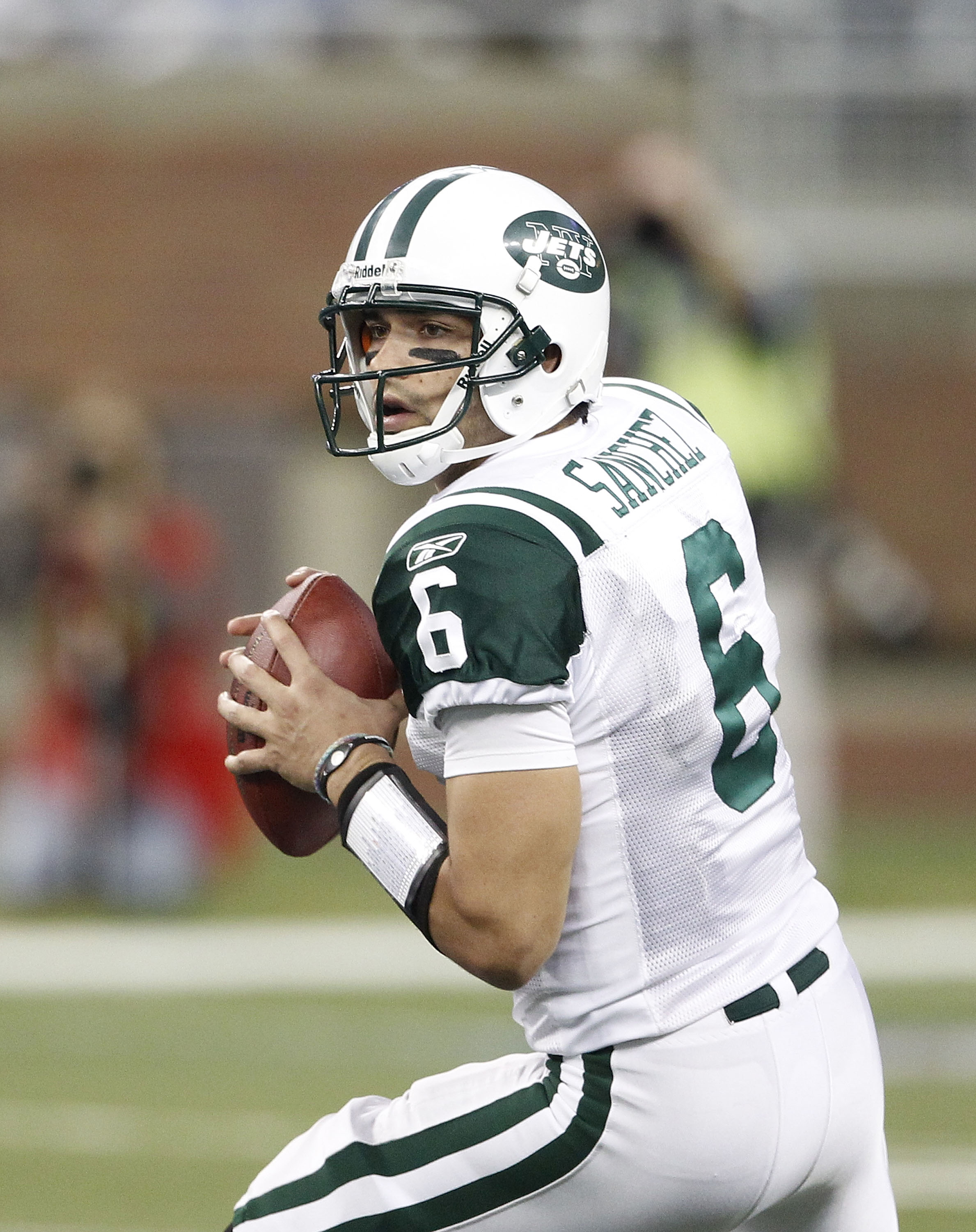 DETROIT - NOVEMBER 07:  Mark Sanchez #6 of the New York Jets looks to throw a pass during the game against the Detroit Lions at Ford Field on November 7, 2010 in Detroit, Michigan. The Jets defeated the Lions 23-20 in overtime.  (Photo by Leon Halip/Getty