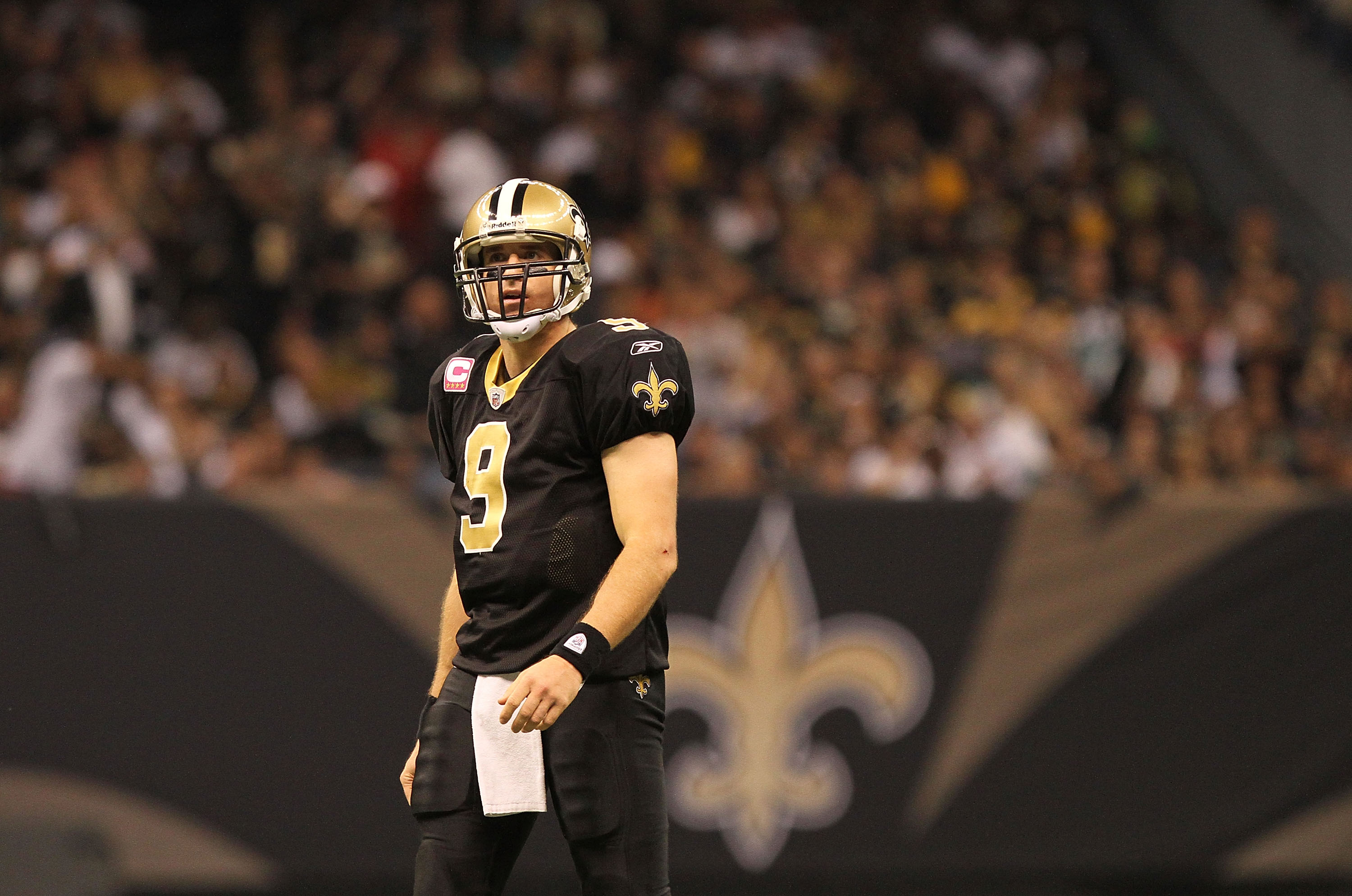 NEW ORLEANS, LA - OCTOBER 31: Drew Brees #9 of the New Orleans Saints looks on during the game against the Pittsburgh Steelers at the Louisiana Superdome on October 31, 2010 in New Orleans, Louisiana. (Photo by Matthew Sharpe/Getty Images)