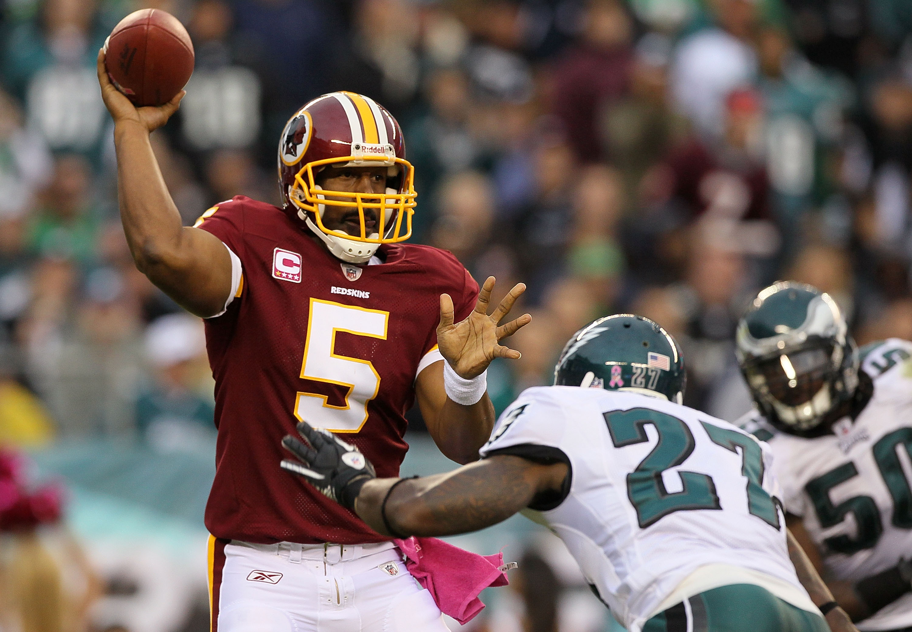 PHILADELPHIA - OCTOBER 03:  Donovan McNabb #5 of the Washington Redskins throws a pass under pressure from Quintin Mikell #27 of the Philadelphia Eagles on October 3, 2010 at Lincoln Financial Field in Philadelphia, Pennsylvania.  (Photo by Jim McIsaac/Ge