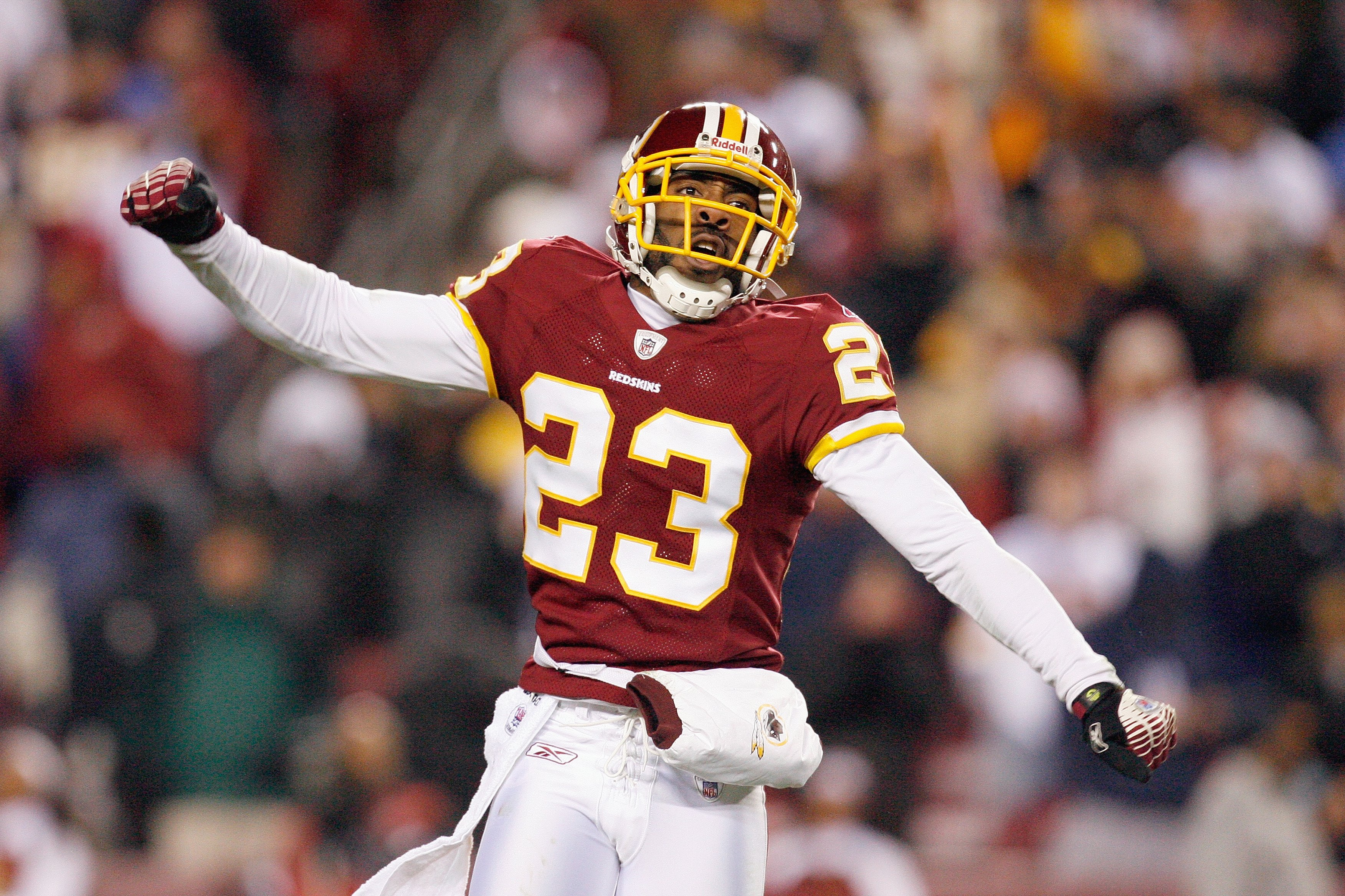 LANDOVER, MD - DECEMBER 21:  DeAngelo Hall #23 of the Washington Redskins celebrates during the game of the Philadelphia Eagles on December 21, 2008 at FedEx Field in Landover, Maryland.  (Photo by Kevin C. Cox/Getty Images)