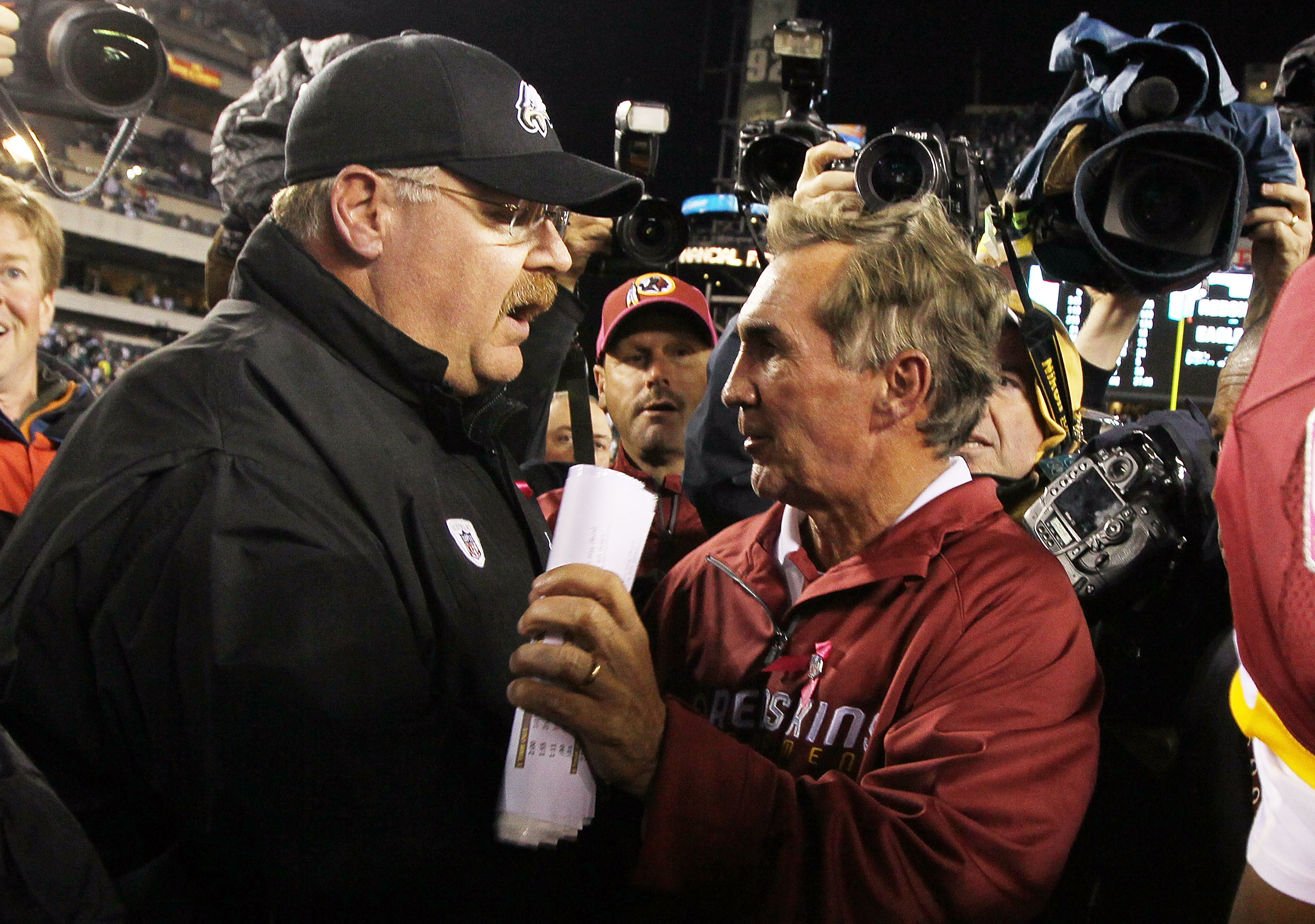 PHILADELPHIA - OCTOBER 03:  Head coach Andy Reid of the Philadelphia Eagles meets with head coach Mike Shanahan of the Washington Redskins after their game on October 3, 2010 at Lincoln Financial Field in Philadelphia, Pennsylvania. The Redskins defeated