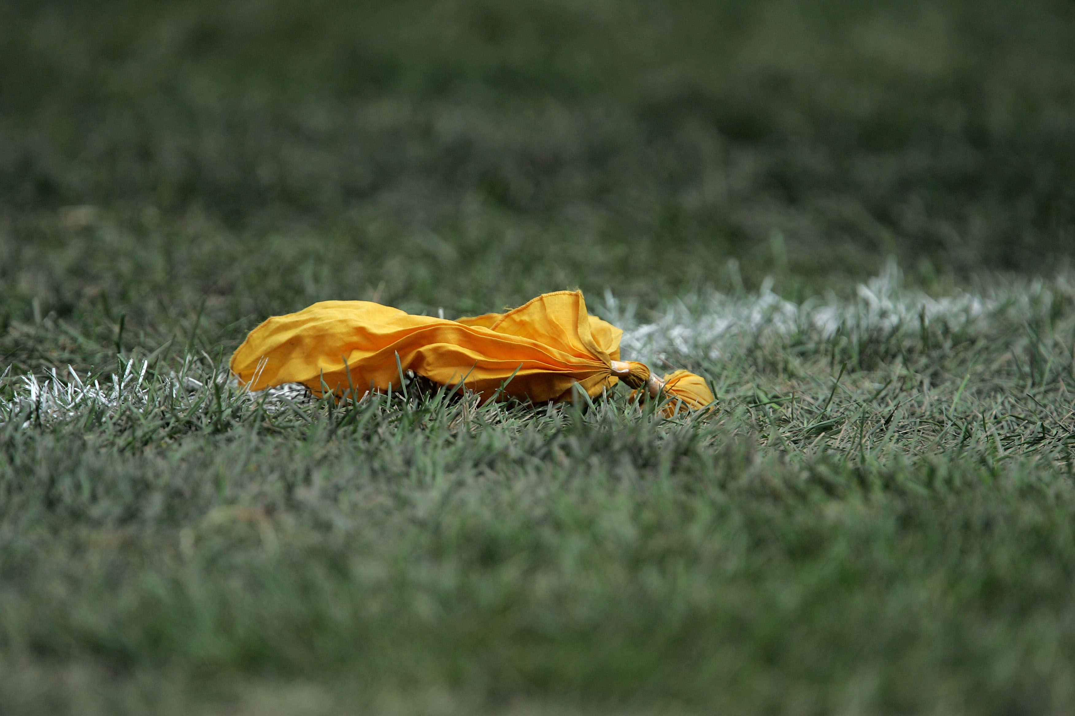 CHICAGO - SEPTEMBER 17:  A yellow penelty flag is seen on the field during the game between the Chicago Bears and the Detroit Lions September 17, 2006 at Soldier Field in Chicago, Illinois. The Bears won 34-7. (Photo by Jonathan Daniel/Getty Images)
