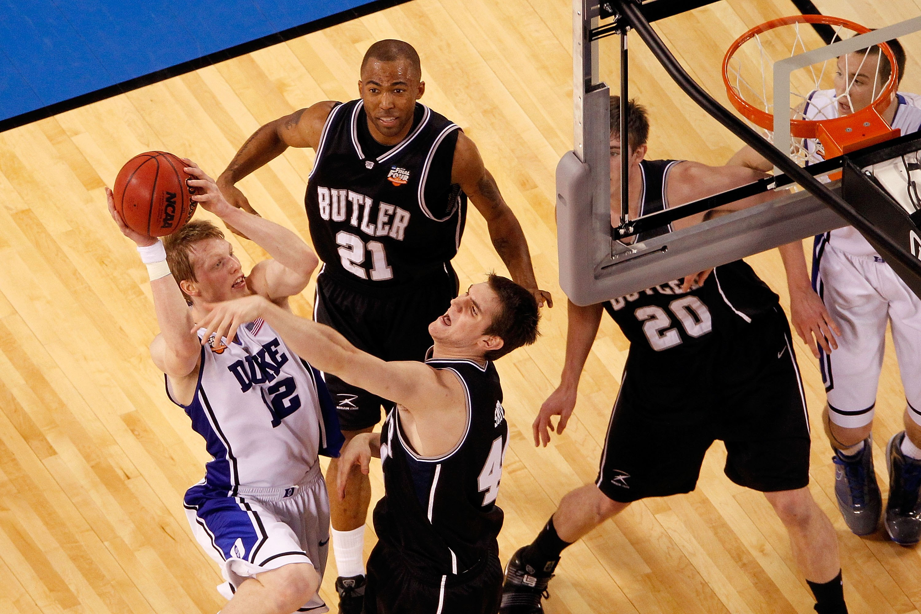 INDIANAPOLIS - APRIL 05:  Kyle Singler #12 of the Duke Blue Devils attempts a shot against the Butler Bulldogs during the 2010 NCAA Division I Men's Basketball National Championship game at Lucas Oil Stadium on April 5, 2010 in Indianapolis, Indiana.  (Ph