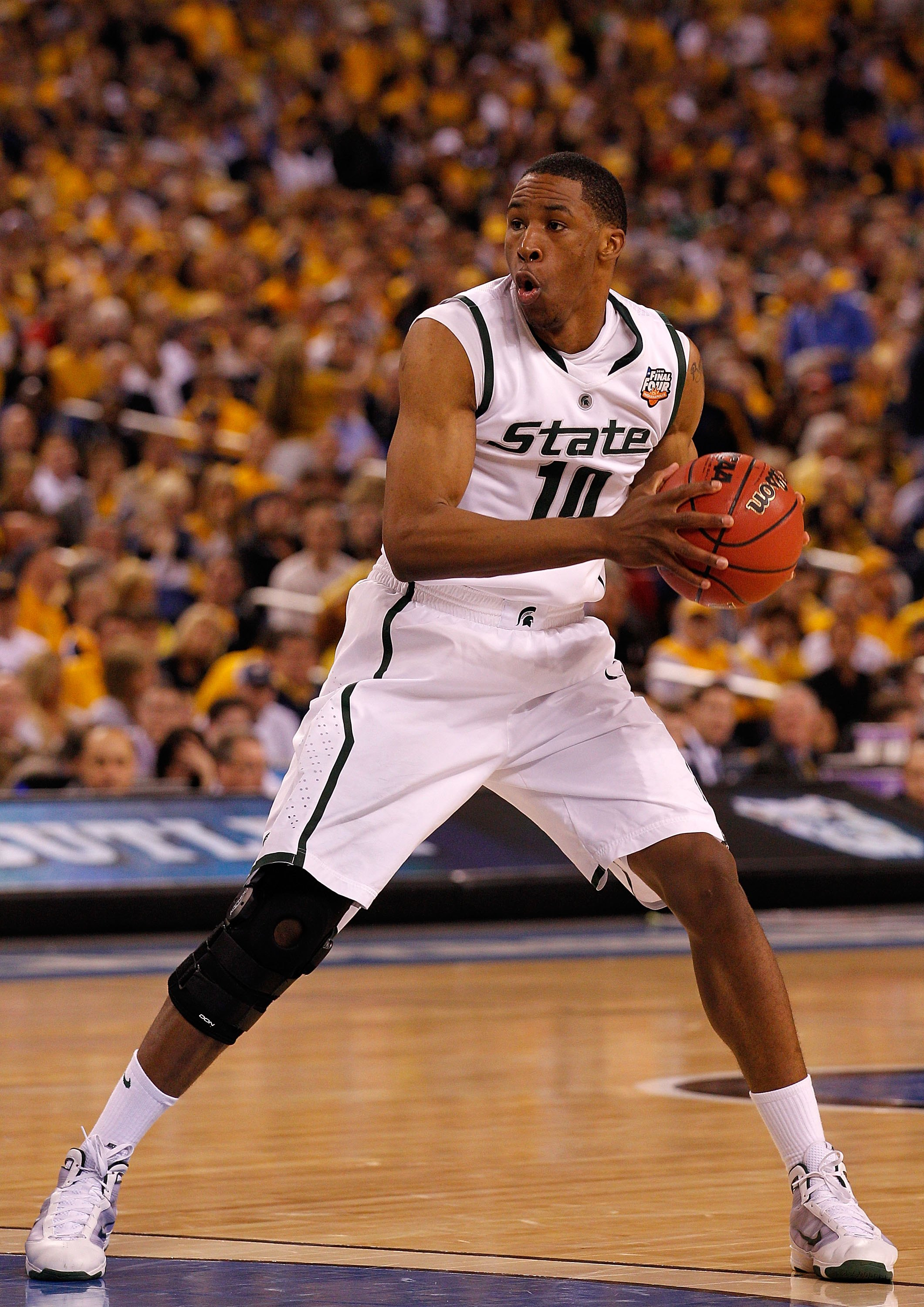 INDIANAPOLIS - APRIL 03:  Delvon Roe #10 of the Michigan State Spartans with the ball against the Butler Bulldogs during the National Semifinal game of the 2010 NCAA Division I Men's Basketball Championship on April 3, 2010 in Indianapolis, Indiana.  (Pho
