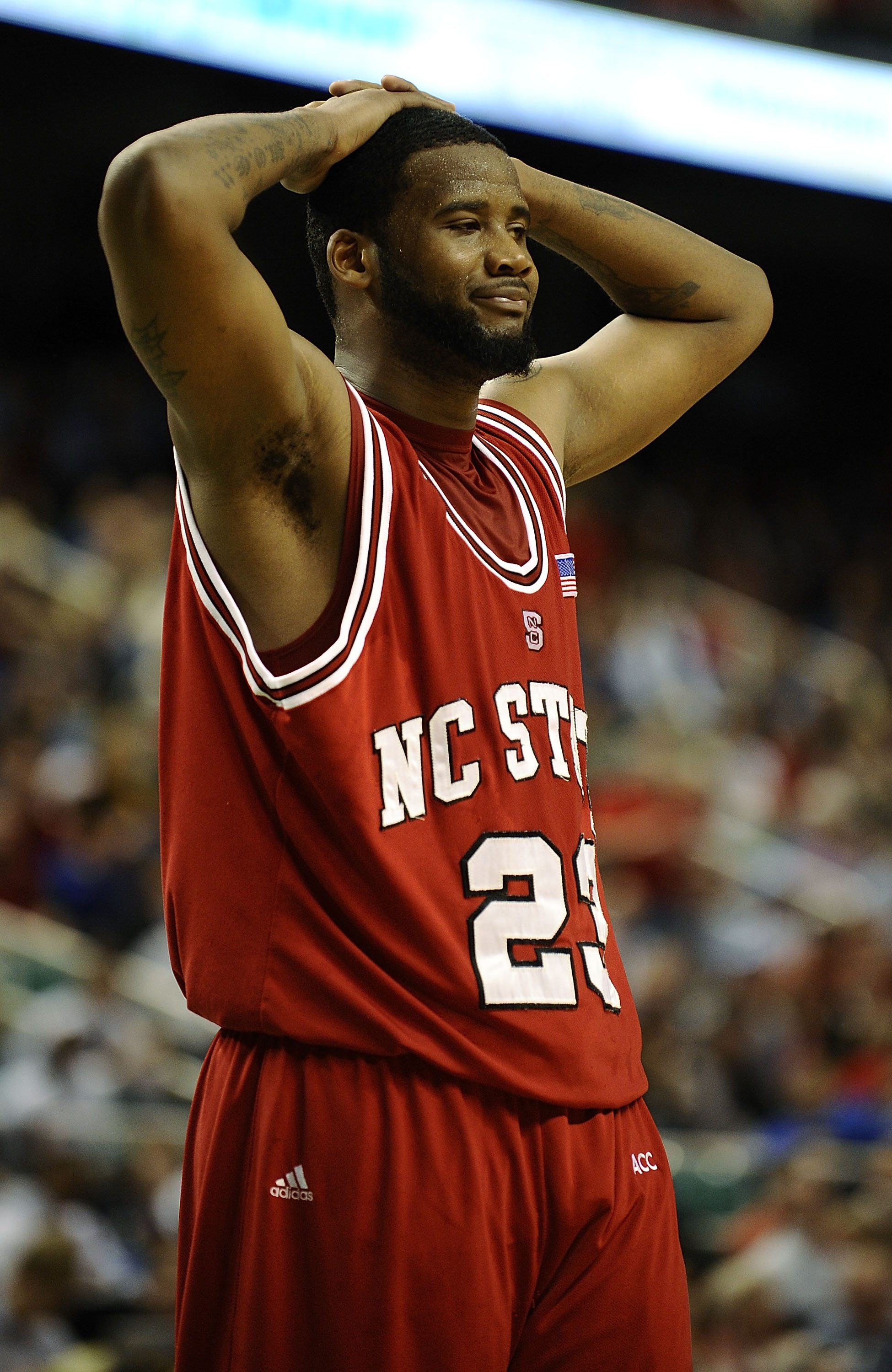 GREENSBORO, NC - MARCH 13:  Tracy Smith #23 of the North Carolina State Wolfpack reacts in a semifinal game against the Georgia Tech Yellow Jackets in the 2010 ACC Men's Basketball Tournament at the Greensboro Coliseum on on March 13, 2010 in Greensboro,