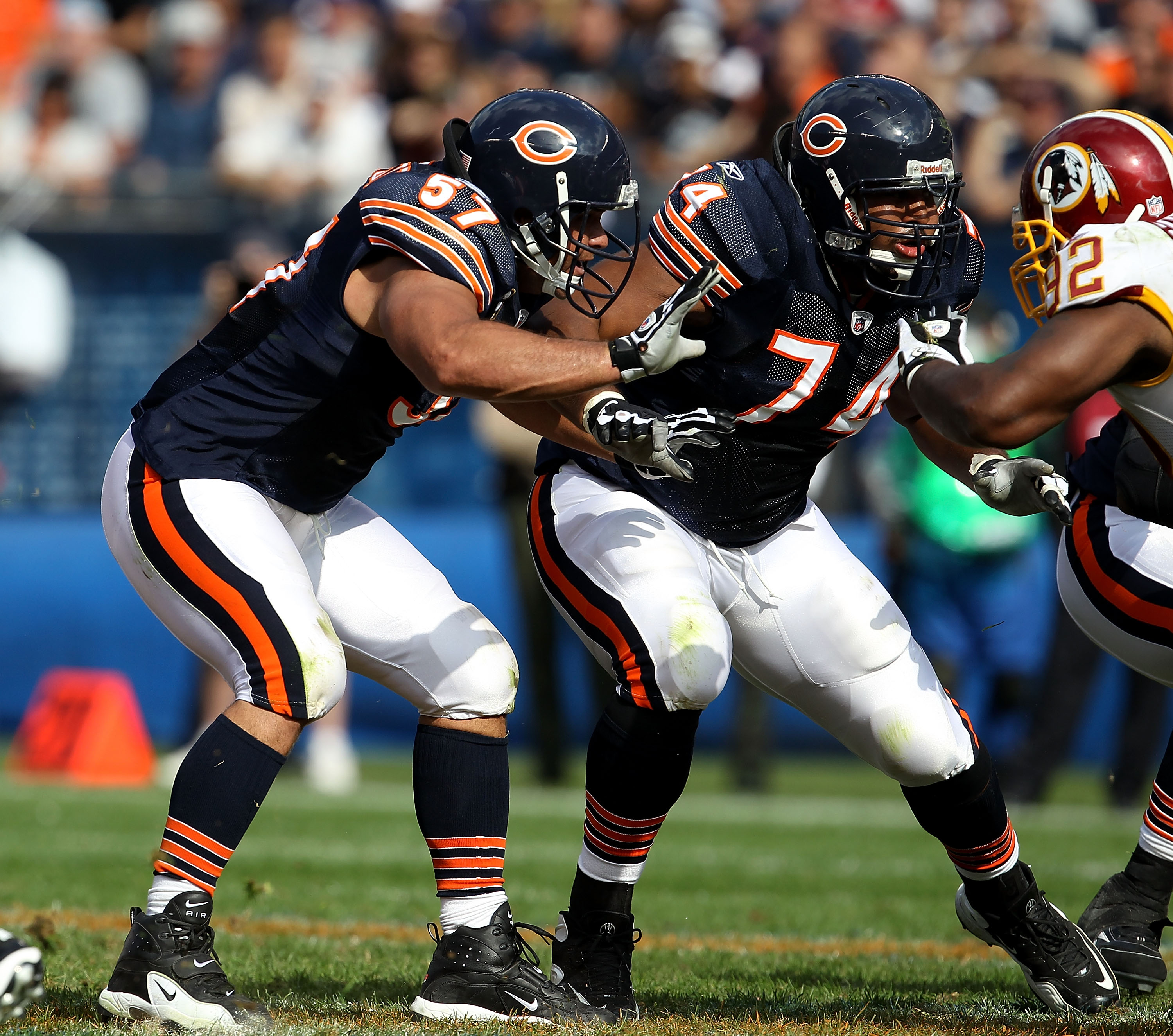 CHICAGO - OCTOBER 24: Olin Kreutz #57 and Chris Williams #74 of the Chicago Bears move to block against the Washington Redskins at Soldier Field on October 24, 2010 in Chicago, Illinois. The Redskins defeated the Bears 17-14. (Photo by Jonathan Daniel/Get