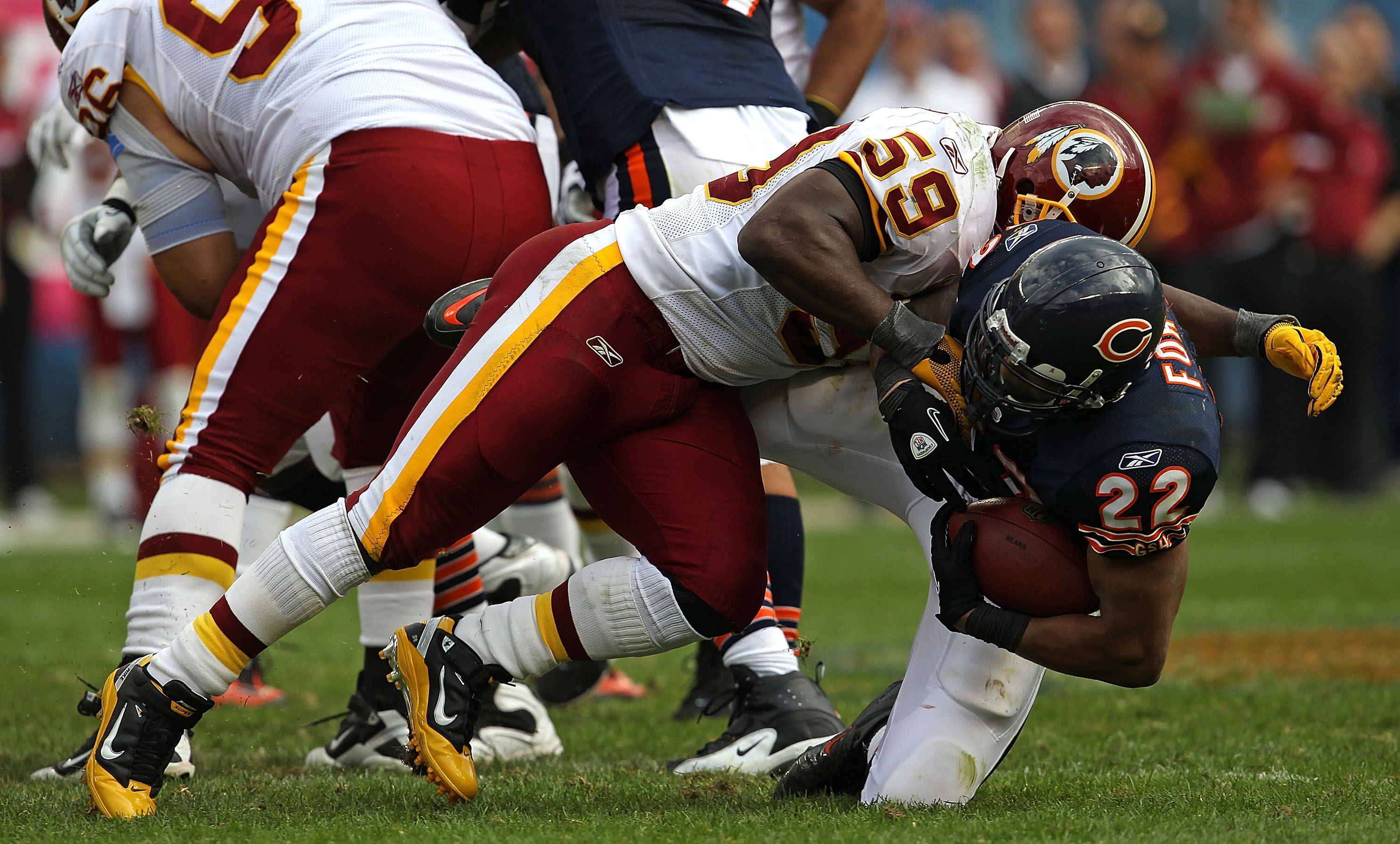 CHICAGO - OCTOBER 24: Matt Forte #22 of the Chicago Bears is dropped by London Fletcher #59 of the Washington Redskins at Soldier Field on October 24, 2010 in Chicago, Illinois. The Redskins defeated the Bears 17-14. (Photo by Jonathan Daniel/Getty Images
