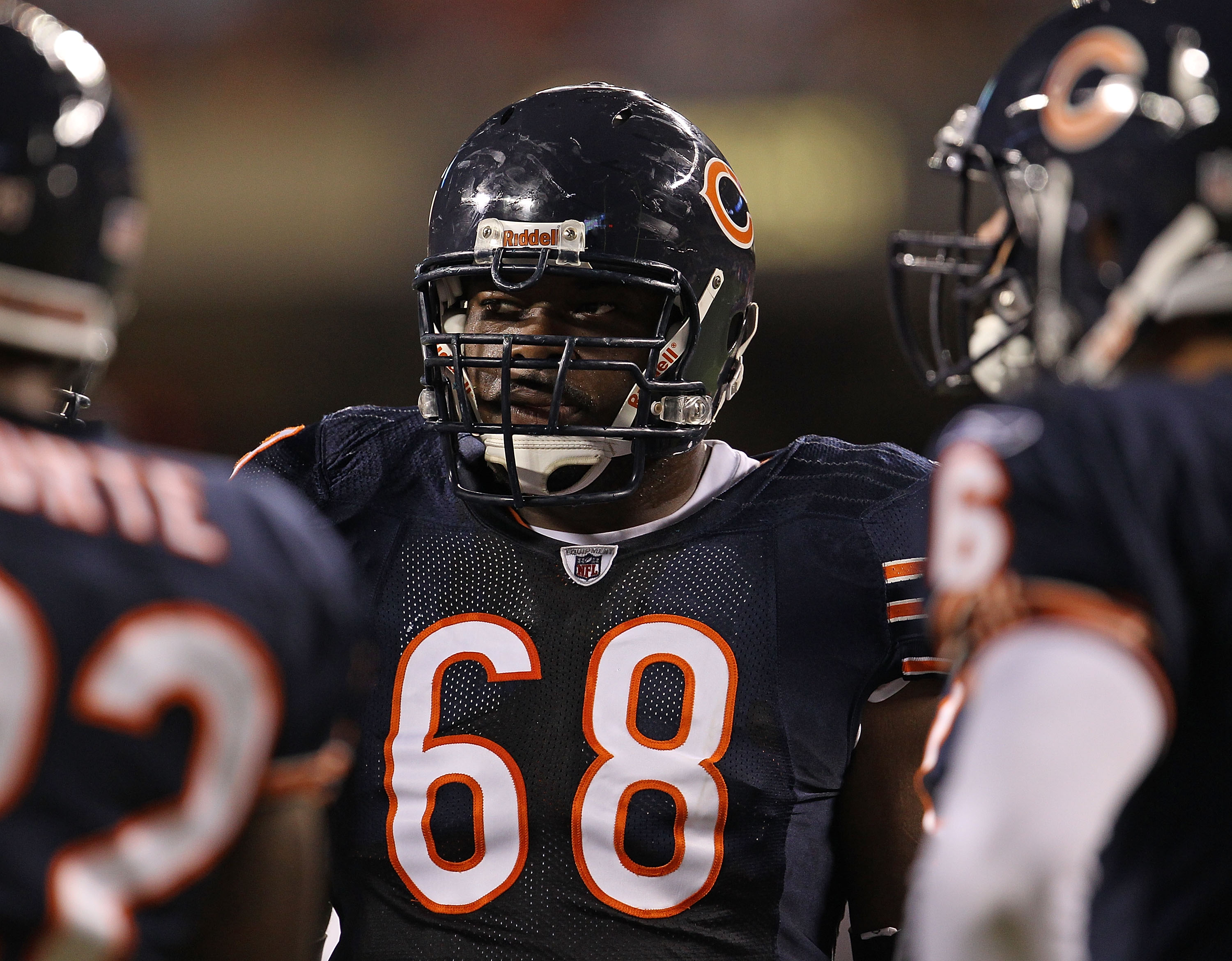 CHICAGO - AUGUST 28: Frank Omiyale #68 of the Chicago Bears waits in the huddle during a preseason game against the Arizona Cardinals at Soldier Field on August 28, 2010 in Chicago, Illinois. The Cardinals defeated the Bears 14-9. (Photo by Jonathan Danie