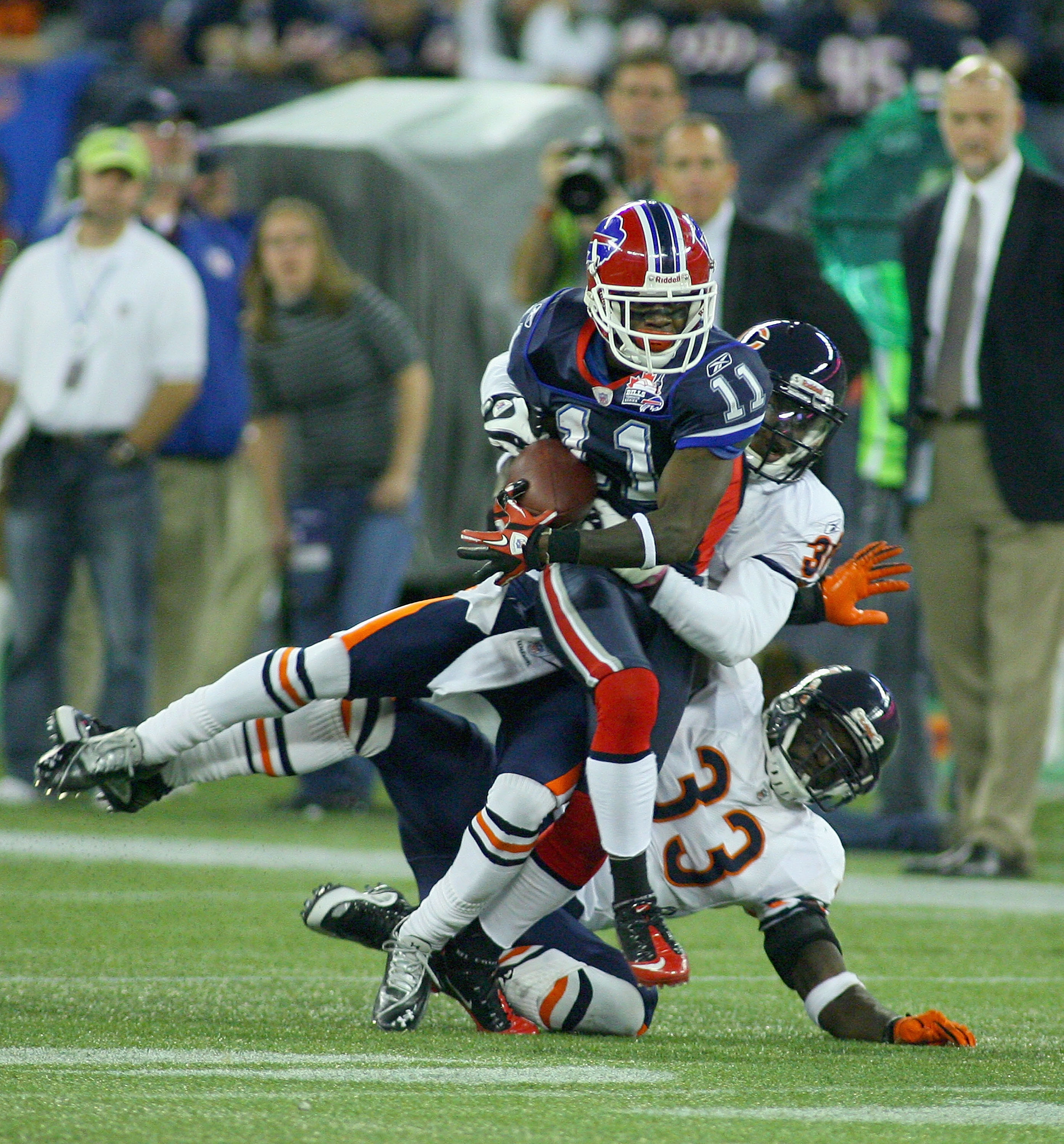 TORONTO, ON - NOVEMBER 07: Roscoe Parrish #11 of the Buffalo Bills is tackled by D.J. Moore #30 and Charles Tillman #33 of the Chicago Bears at Rogers Centre on November 7, 2010 in Toronto, Canada.  Chicago won 22-19. (Photo by Rick Stewart/Getty Images)