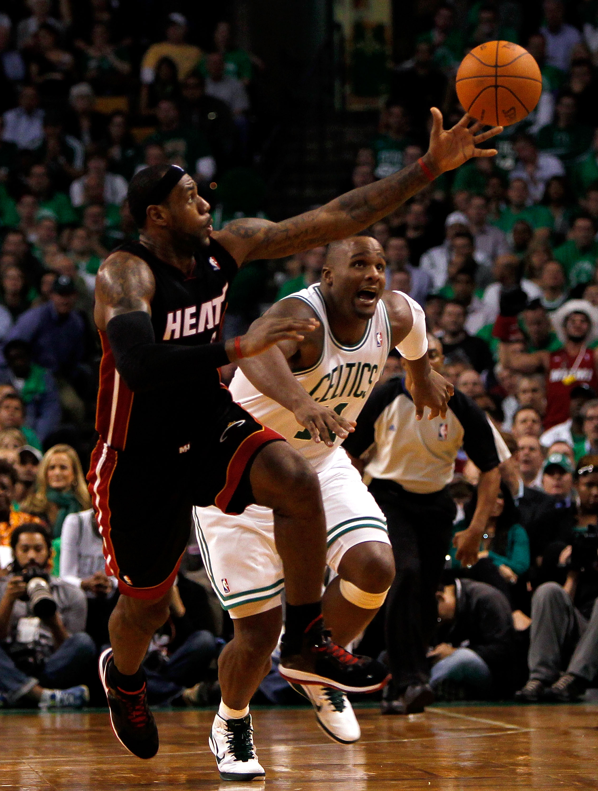 BOSTON, MA - OCTOBER 26:  LeBron James #6 of the Miami Heat beats Glen Davis #11 of the Boston Celtics to a loose ball at the TD Banknorth Garden on October 26, 2010 in Boston, Massachusetts. NOTE TO USER: User expressly acknowledges and agrees that, by d