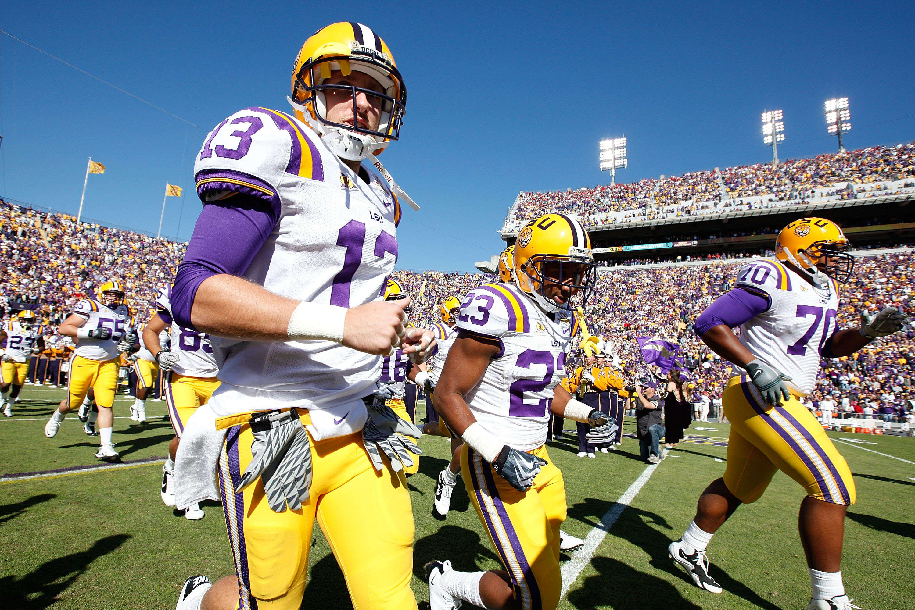 BATON ROUGE, LA - NOVEMBER 06:  Members of the Louisiana State University Tigers run onto the field during pregame before playing the Alabama Crimson Tide  at Tiger Stadium on November 6, 2010 in Baton Rouge, Louisiana.  (Photo by Chris Graythen/Getty Ima