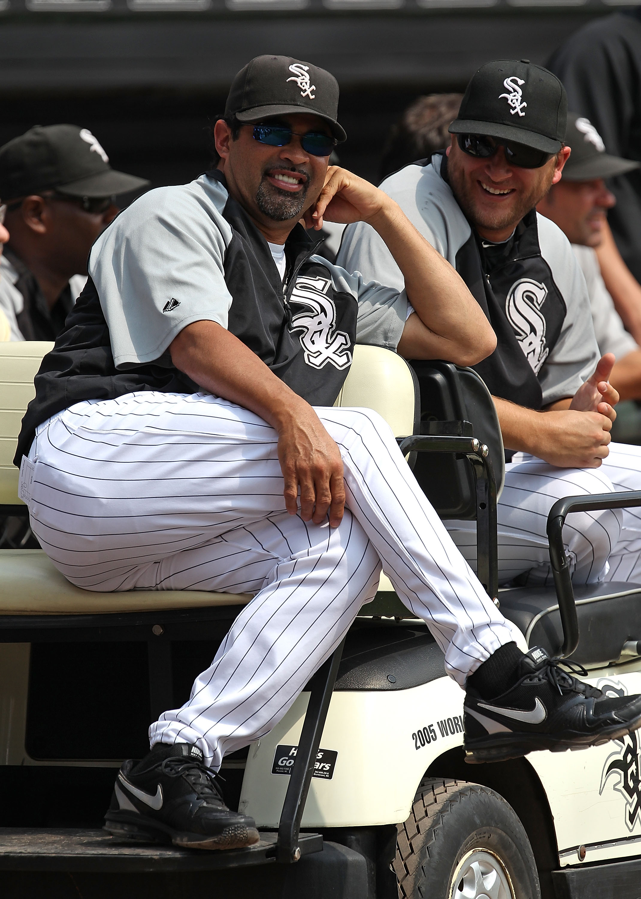CHICAGO - AUGUST 29: Manager Ozzie Guillen #13 (L) and Mark Buehrle #56 of the Chicago White Sox enjoy a ceremony retiring former player Frank Thomas' number 35 before a game against the New York Yankees at U.S. Cellular Field on August 29, 2010 in Chicag