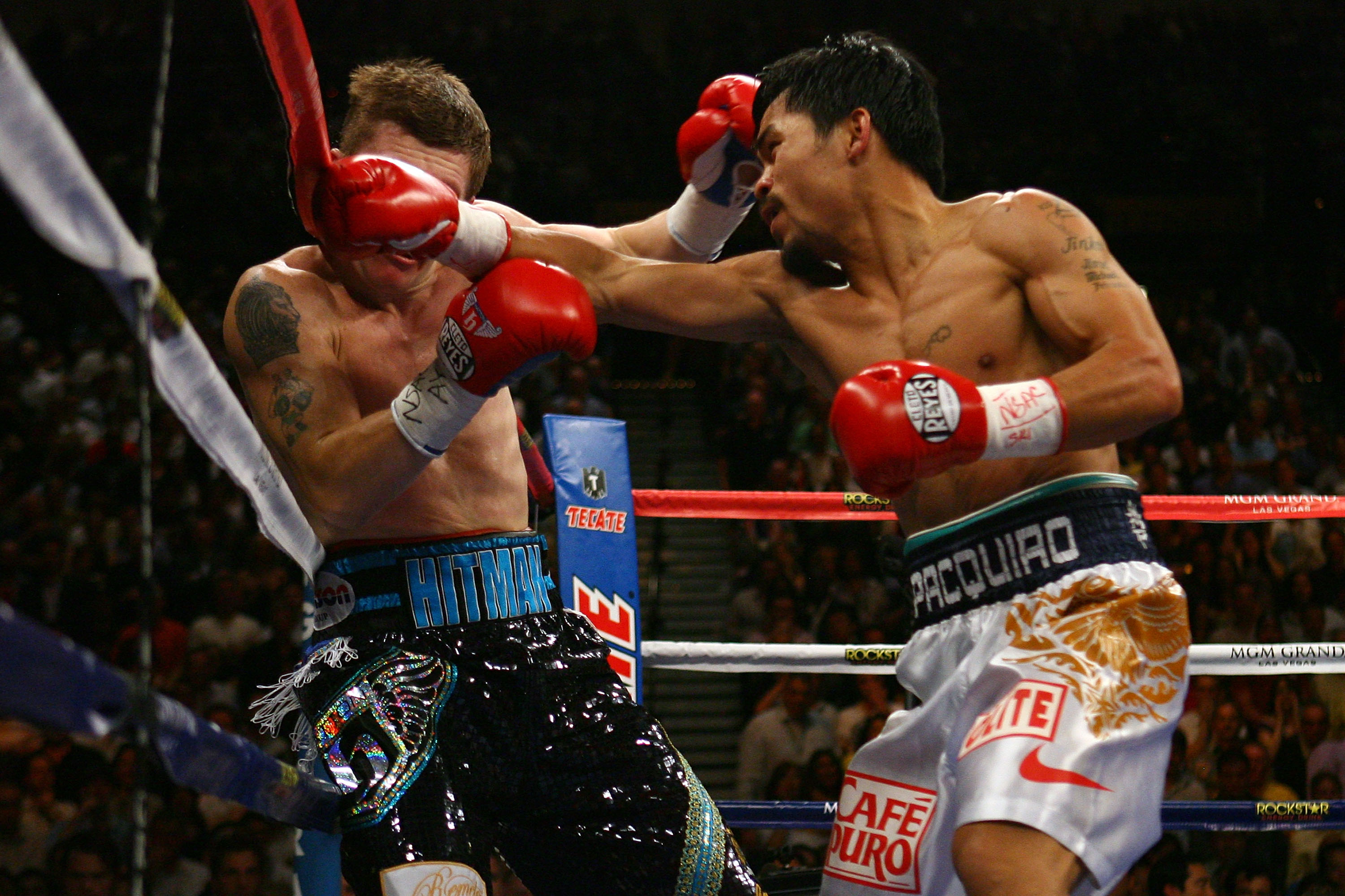 LAS VEGAS - MAY 02:  (R-L) Manny Pacquiao of the Philippines connects with a right to the face of Ricky Hatton of England in the first round of their junior welterweight title fight at the MGM Grand Garden Arena May 2, 2009 in Las Vegas, Nevada. Pacquiao