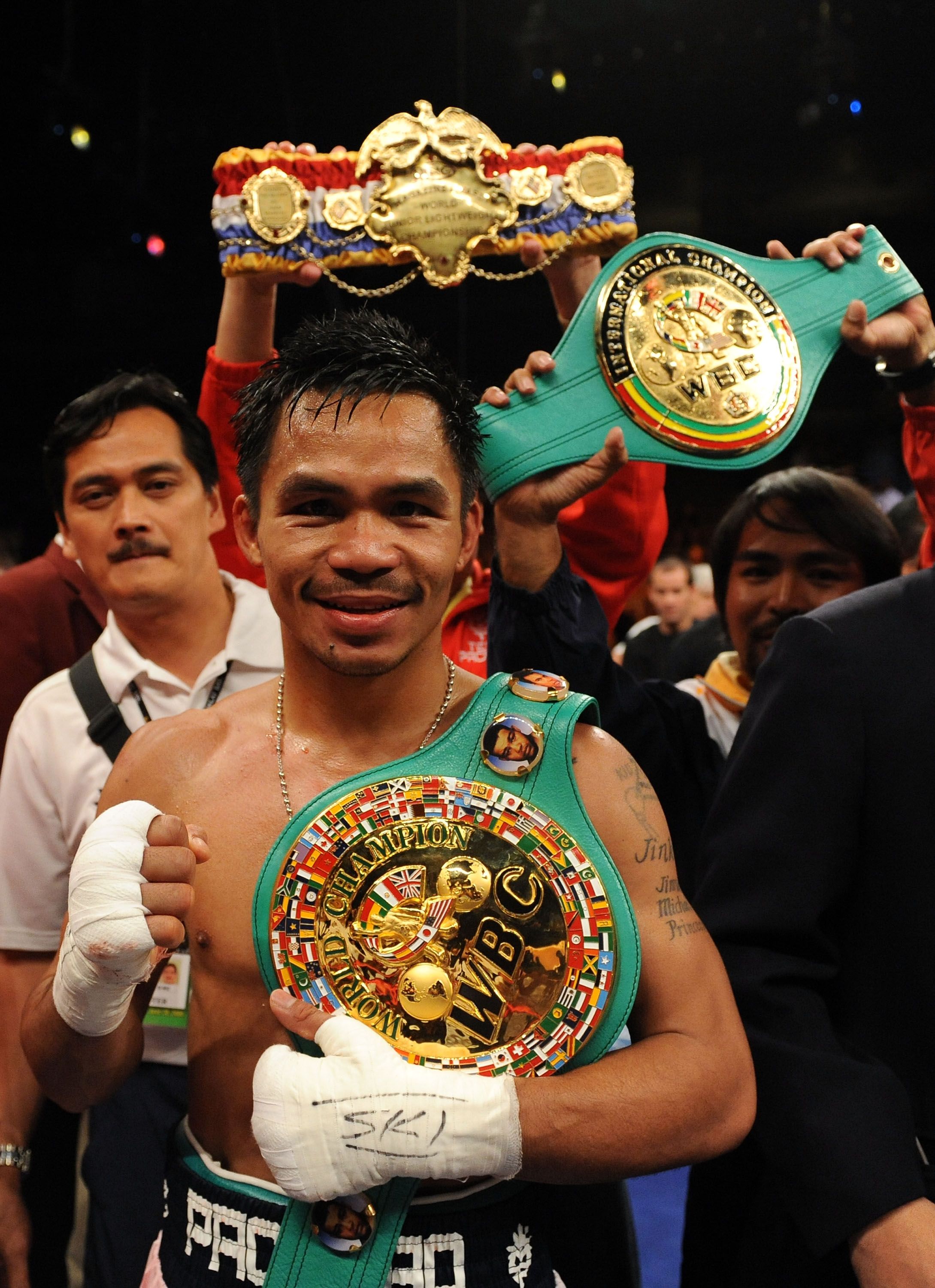 LAS VEGAS - JUNE 28:  Manny Pacquiao of the Philippines poses with his belts after he knocks out David Diaz during the ninth round of the WBC Lightweight Championship at the Mandalay Bay Events Center on June 28, 2008 in Las Vegas, Nevada.  (Photo by Harr