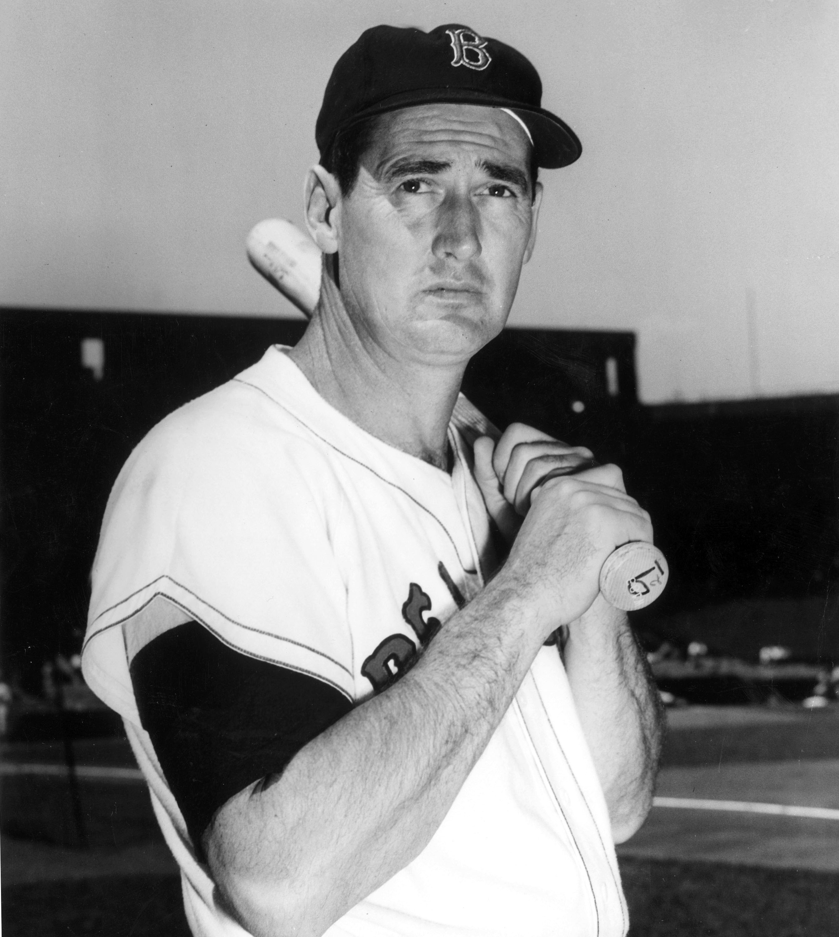 BOSTON - AUGUST 22, 1958:  (FILE PHOTO) Baseball legend Ted Williams (1918 - 2002) of the Boston Red Sox holds a baseball bat at Shriner's Day in Fenway Park August 22, 1958 in Boston, Massachusetts. The 83-year-old Williams, who was the last major league