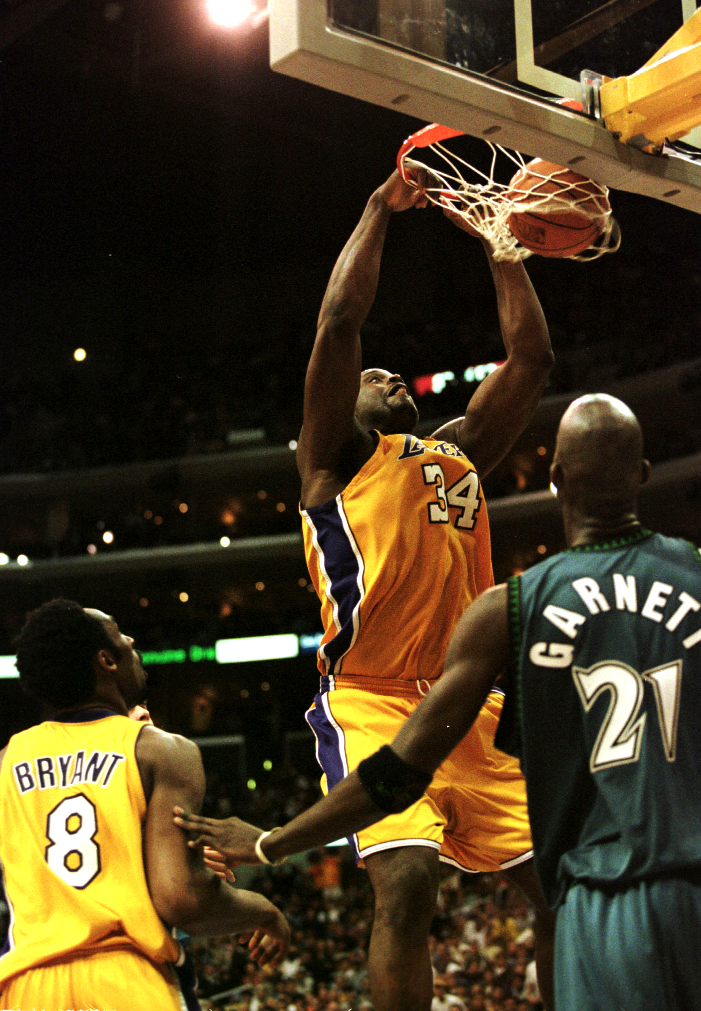 16 Apr 2000: Shaquille O''Neal #34 of the Los Angeles Lakers slam dunks the ball as teammate Kobe Bryant #8 and Kevin Garnett #21 of the Minnesota Timberwolves look on during their game at the Staples Center in Los Angeles, California. The Lakers defeated