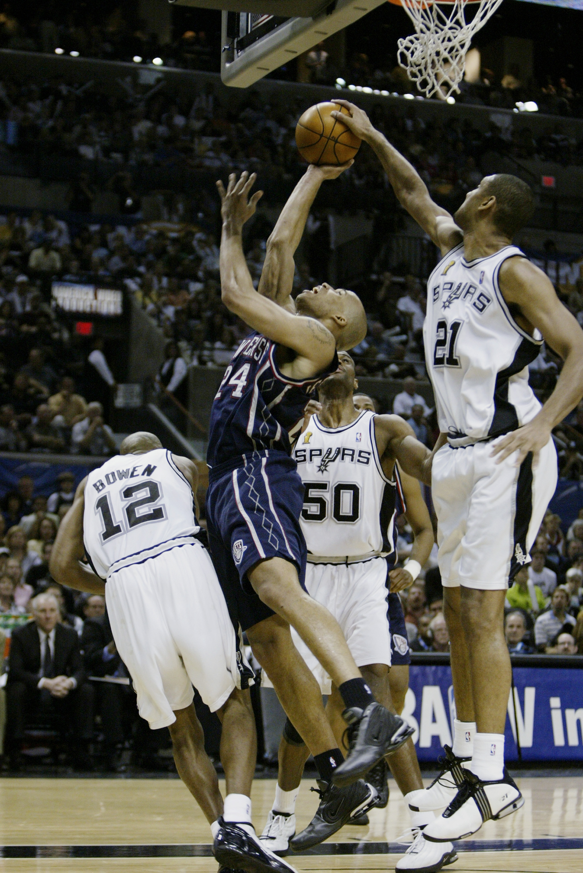 SAN ANTONIO, TX - JUNE 15:  Tim Duncan #21 of the San Antonio Spurs gets a hand on a shot by Richard Jefferson #24 of the New Jersey Nets during game six of the 2003 NBA Finals on June 15, 2003 at the SBC Center in San Antonio, Texas.  The Spurs won 88-77