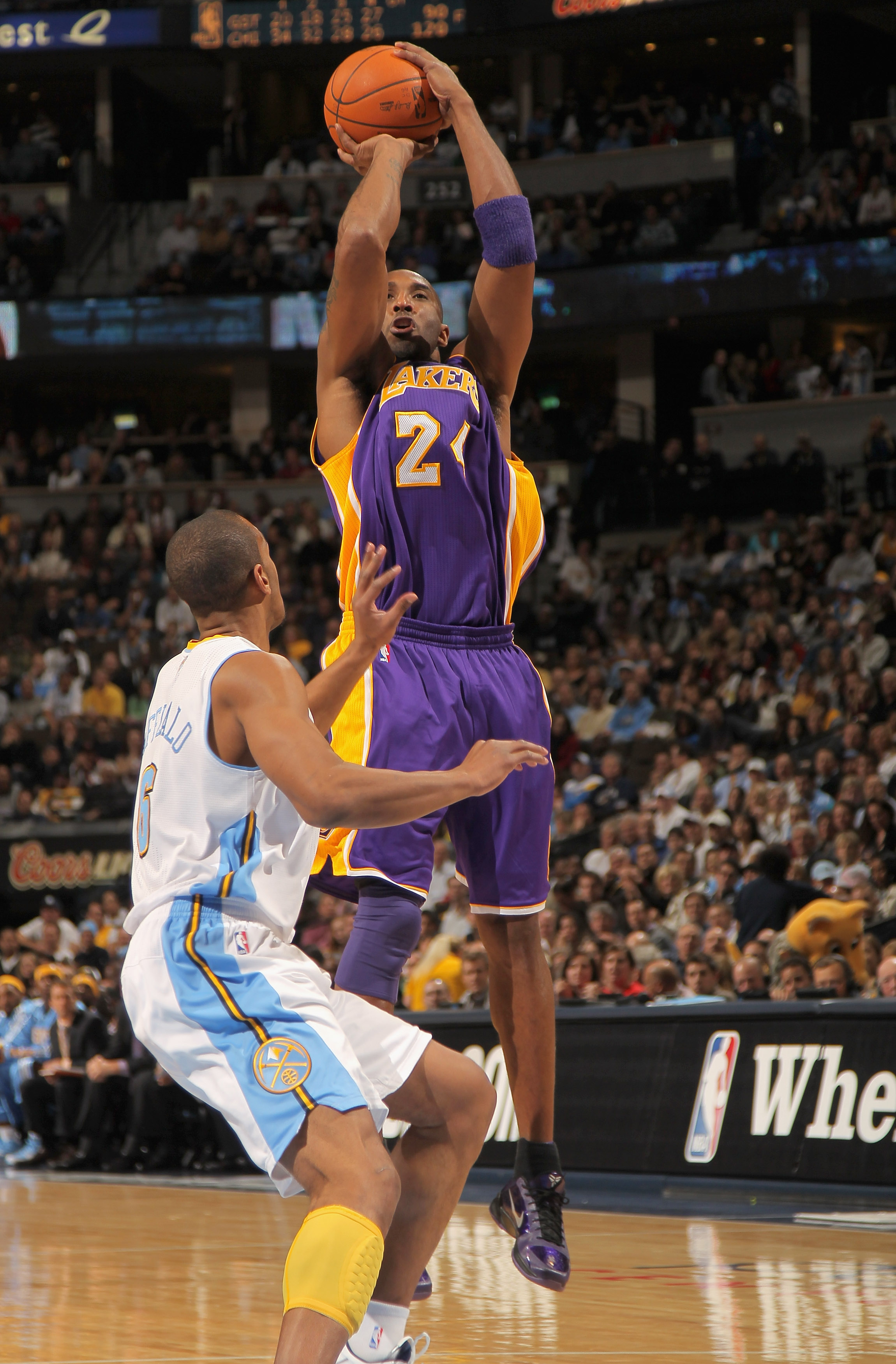 DENVER - NOVEMBER 11:  Kobe Bryant #24 of the Los Angeles Lakers takes a shot over Arron Afflalo #6 of the Denver Nuggets at the Pepsi Center on November 11, 2010 in Denver, Colorado. The Nuggets defeated the Lakers 118-112.  NOTE TO USER: User expressly