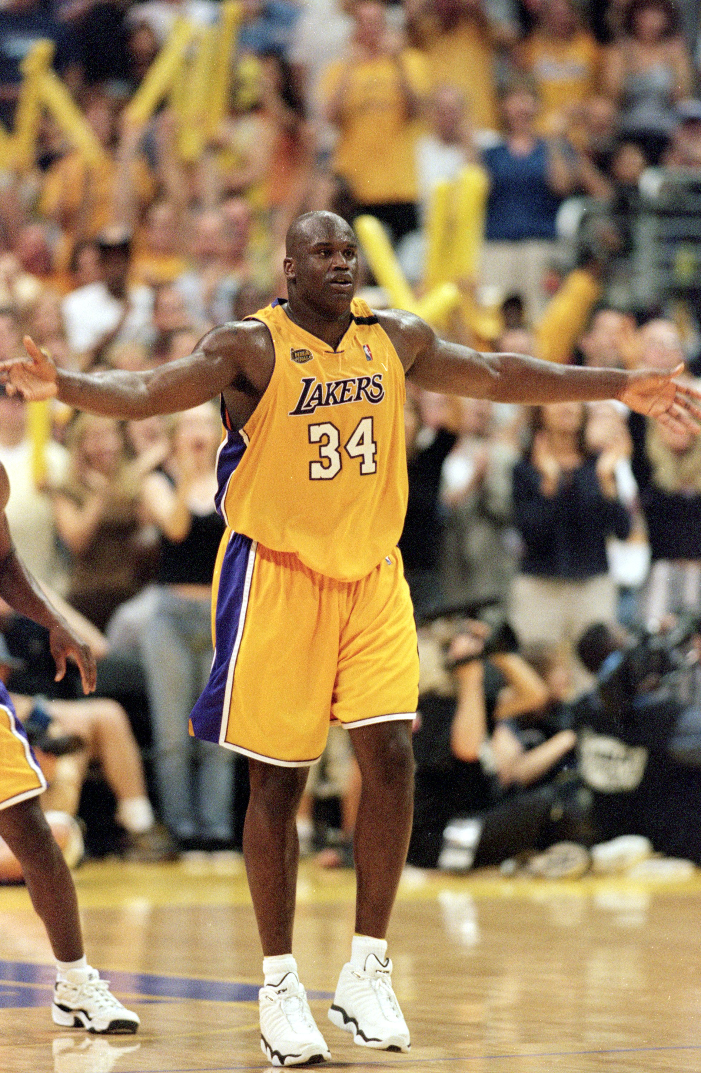 19 Jun 2000:  Shaquille O''Neal #34 of the Los Angeles Lakers celebrates on the court during the NBA Finals Game 6 against the Indiana Pacers at the Staples Center in Los Angeles, California.  The Lakers defeated the Pacers in 116-111.    NOTE TO USER: It