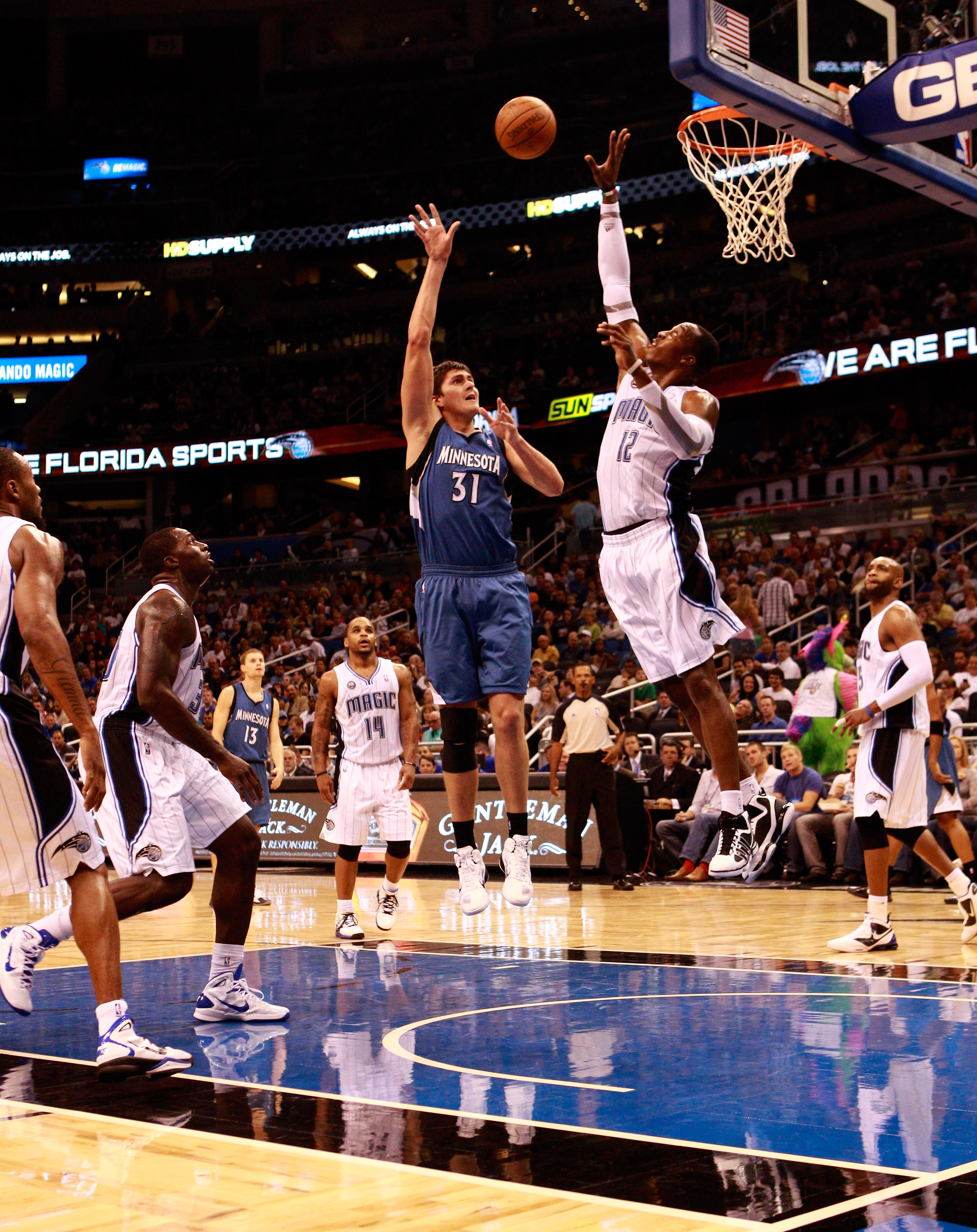 ORLANDO, FL - NOVEMBER 03:  Dwight Howard #12 of the Orlando Magic attempts to block the shot of Darko Milicic #31 of the Minnesota Timberwolves during the game at Amway Arena on November 3, 2010 in Orlando, Florida.  NOTE TO USER: User expressly acknowle