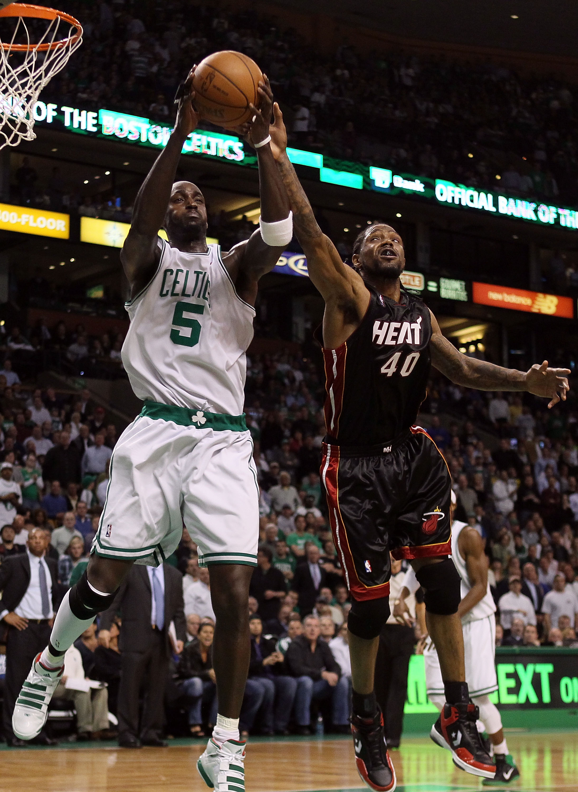 BOSTON - APRIL 27:  Kevin Garnett #5 of the Boston Celtics nabs the rebound from Udonis Haslem #40 of the Miami Heat during Game Five of the Eastern Conference Quarterfinals of the 2010 NBA playoffs at the TD Garden on April 27, 2010 in Boston, Massachuse