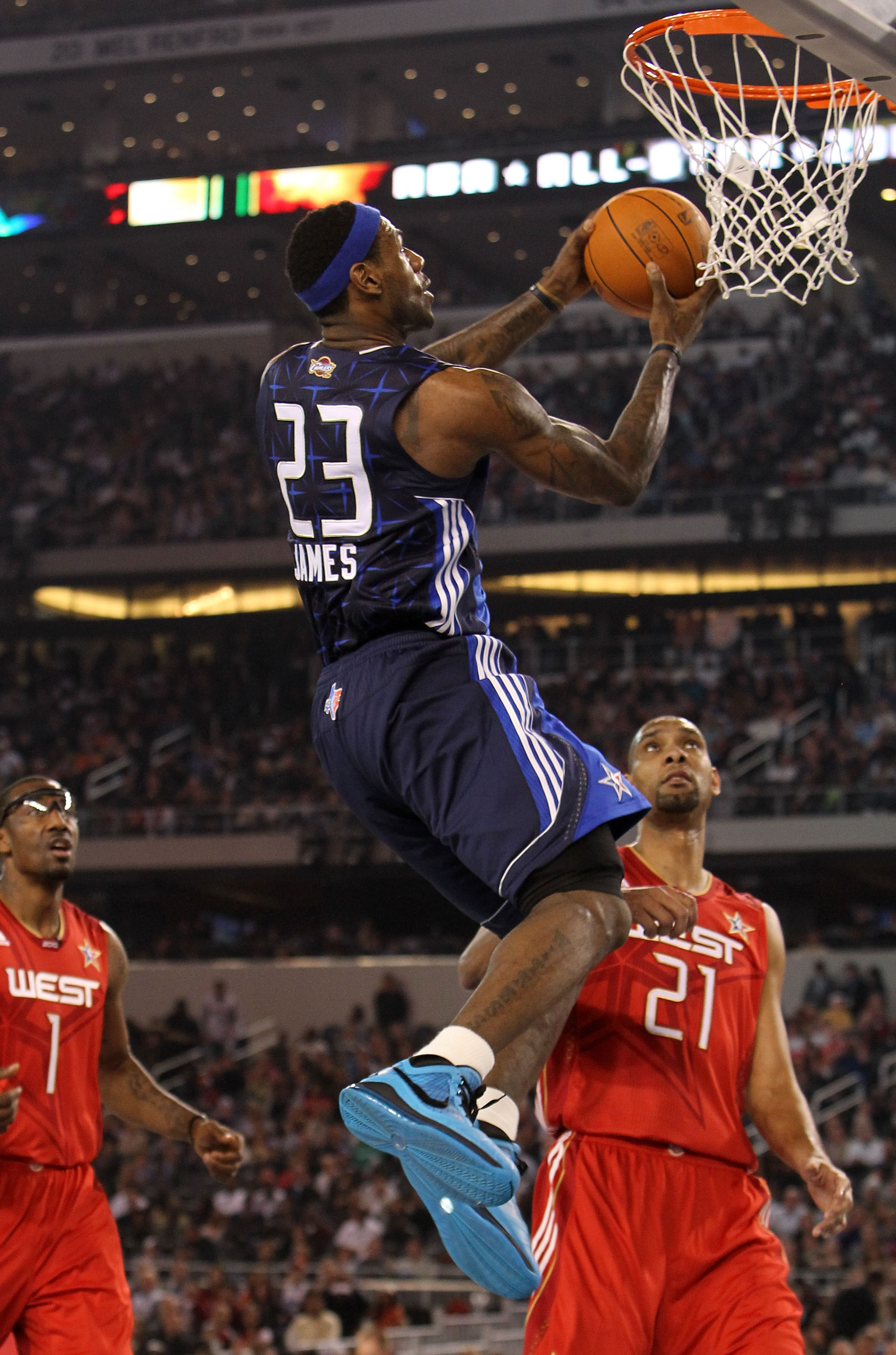 ARLINGTON, TX - FEBRUARY 14:  LeBron James #23 of the Eastern Conference goes up for a shot against Tim Duncan #21 of the Western Conference during the third quarter of the NBA All-Star Game, part of 2010 NBA All-Star Weekend at Cowboys Stadium on Februar