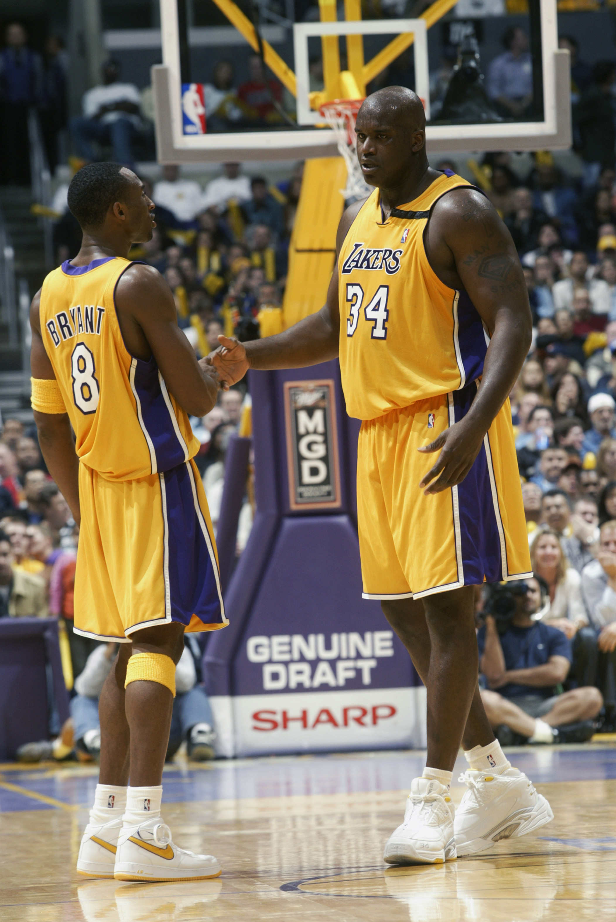 LOS ANGELES - NOVEMBER 22:  Kobe Bryant #8 and Shaquille O'Neal #34 of the Los Angeles Lakers congratulate each other during the NBA game against the Chicago Bulls at Staples Center on November 22, 2002 in Los Angeles, California.  The Lakers won 86-73.