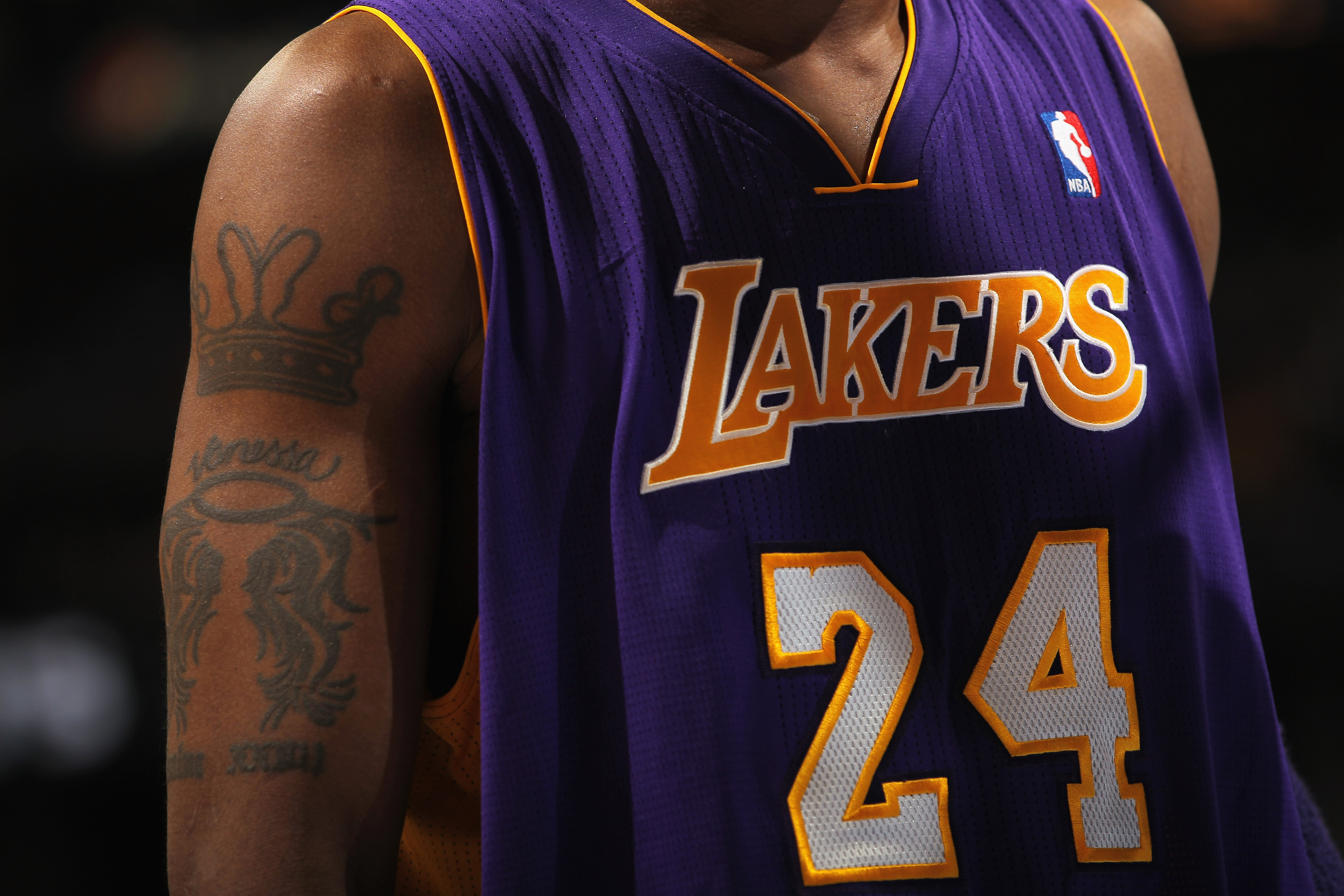 DENVER - NOVEMBER 11:  A detail of the jersey and tattoo of Kobe Bryant #24 of the Los Angeles Lakers as they face the Denver Nuggets at the Pepsi Center on November 11, 2010 in Denver, Colorado. The Nuggets defeated the Lakers 118-112.  NOTE TO USER: Use