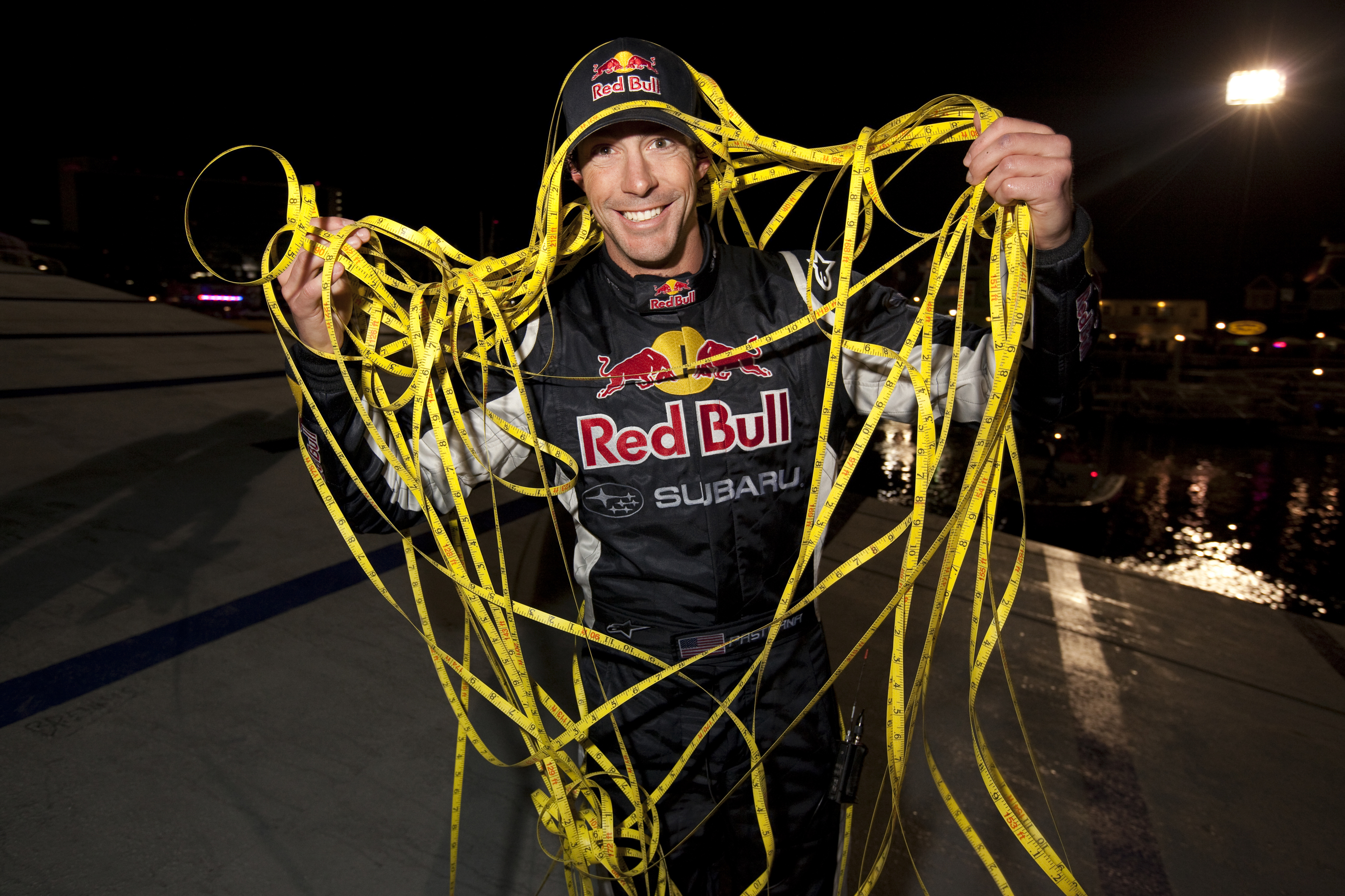 LONG BEACH, CA - DECEMBER 31: In this handout image provided by Red Bull Photofiles, Travis Pastrana poses after breaking the world record for the longest distance jump in a rally car on December 31, 2009 in Long Beach, California. The ramp to ramp jump w