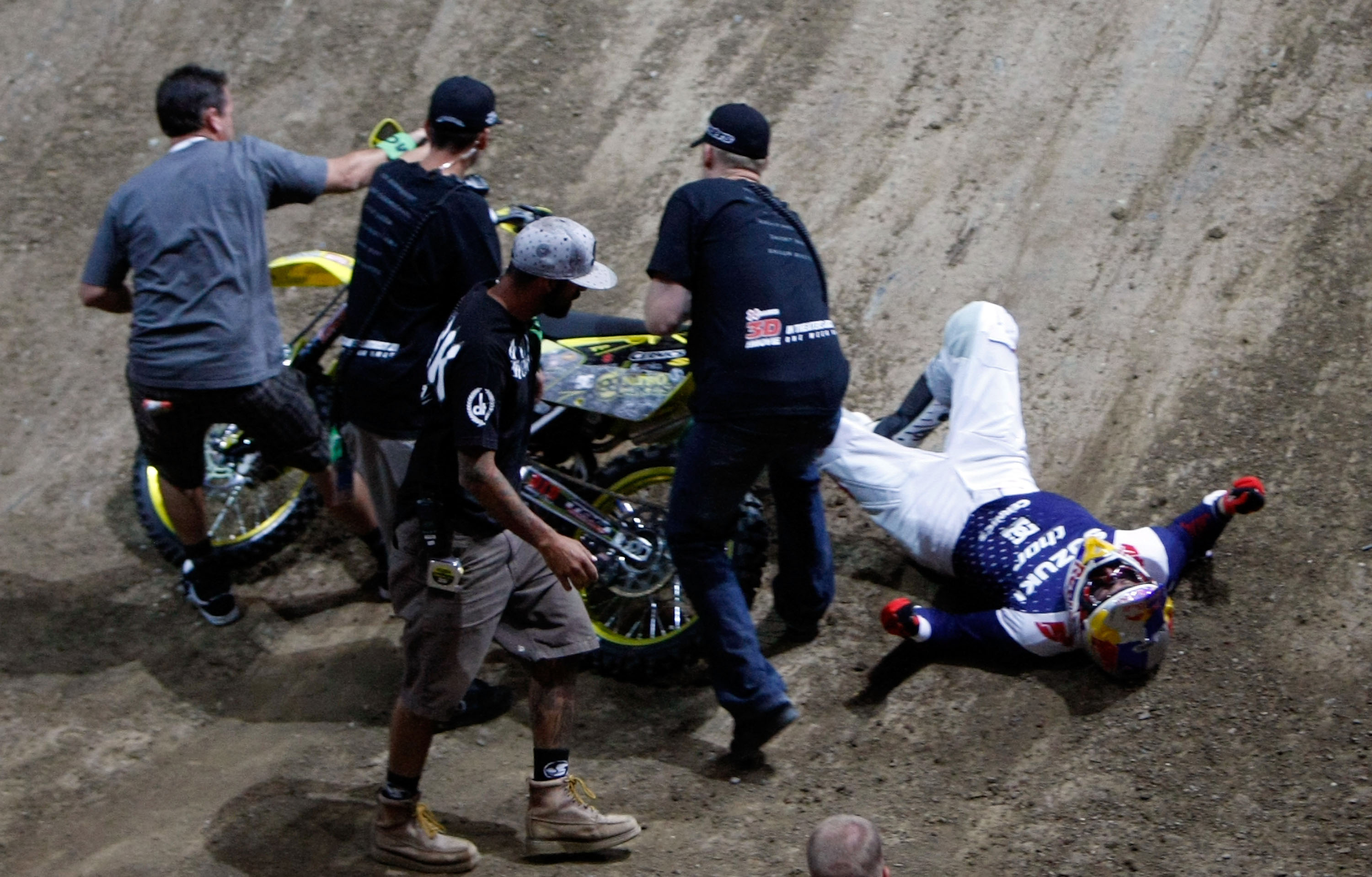 LOS ANGELES, CA - JULY 31:  Travis Pastrana is attended to after crashing while competing in the Moto X Best Trick Final during X Games 15 at Staples Center on July 31, 2009 in Los Angeles, California.  (Photo by Jeff Gross/Getty Images)