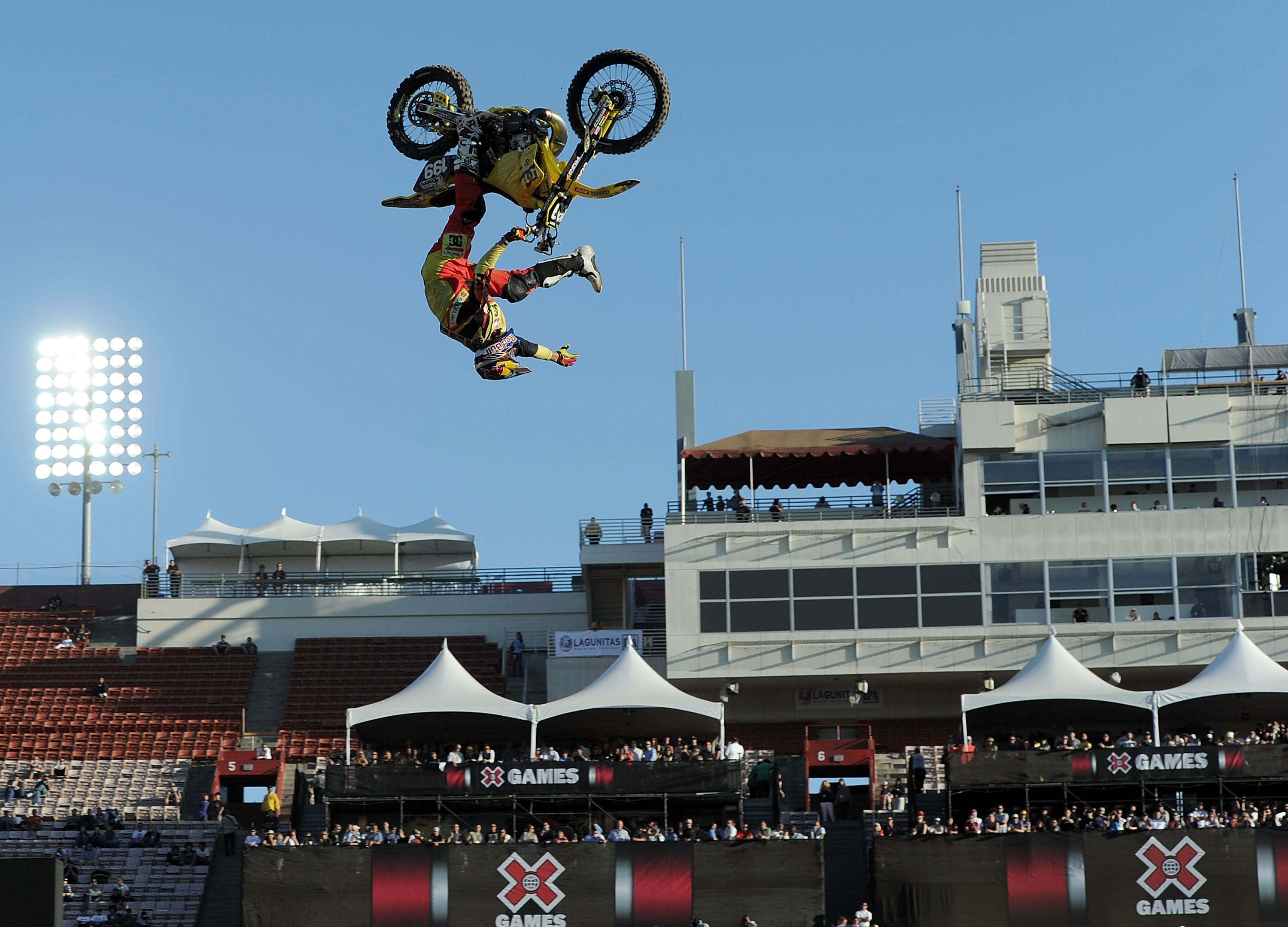 LOS ANGELES, CA - JULY 29:  Travis Pastrana competes in the Moto X Freestyle Final during X Games 16 at the LA Coliseum on July 29, 2010 in Los Angeles, California. Pastrana would win the gold medal.  (Photo by Harry How/Getty Images)