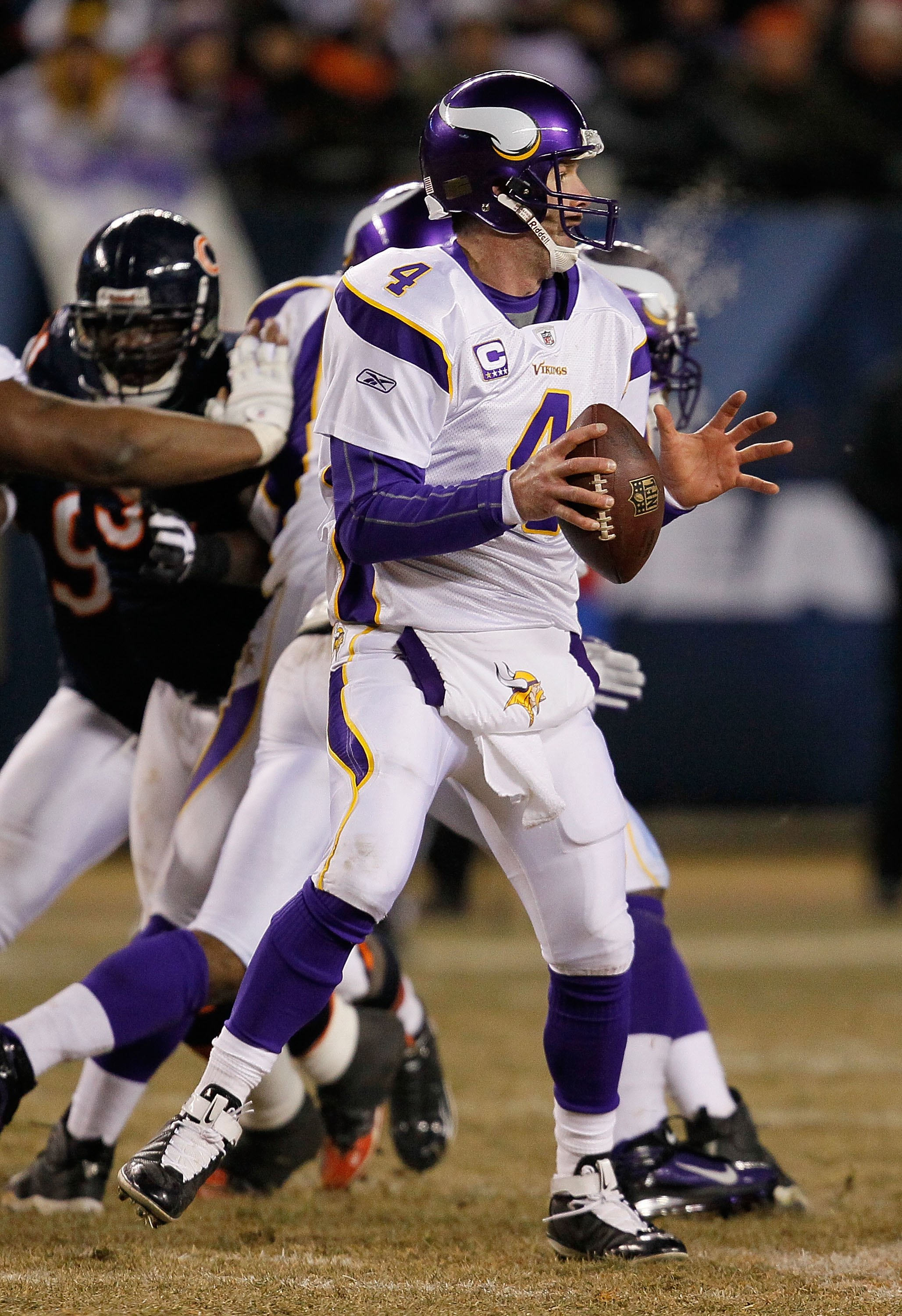 CHICAGO - DECEMBER 28: Brett Favre #4 of the Minnesota Vikings looks for a receiver against the Chicago Bears at Soldier Field on December 28, 2009 in Chicago, Illinois. The Bears defeated the Vikings 36-30 in overtime. (Photo by Jonathan Daniel/Getty Ima